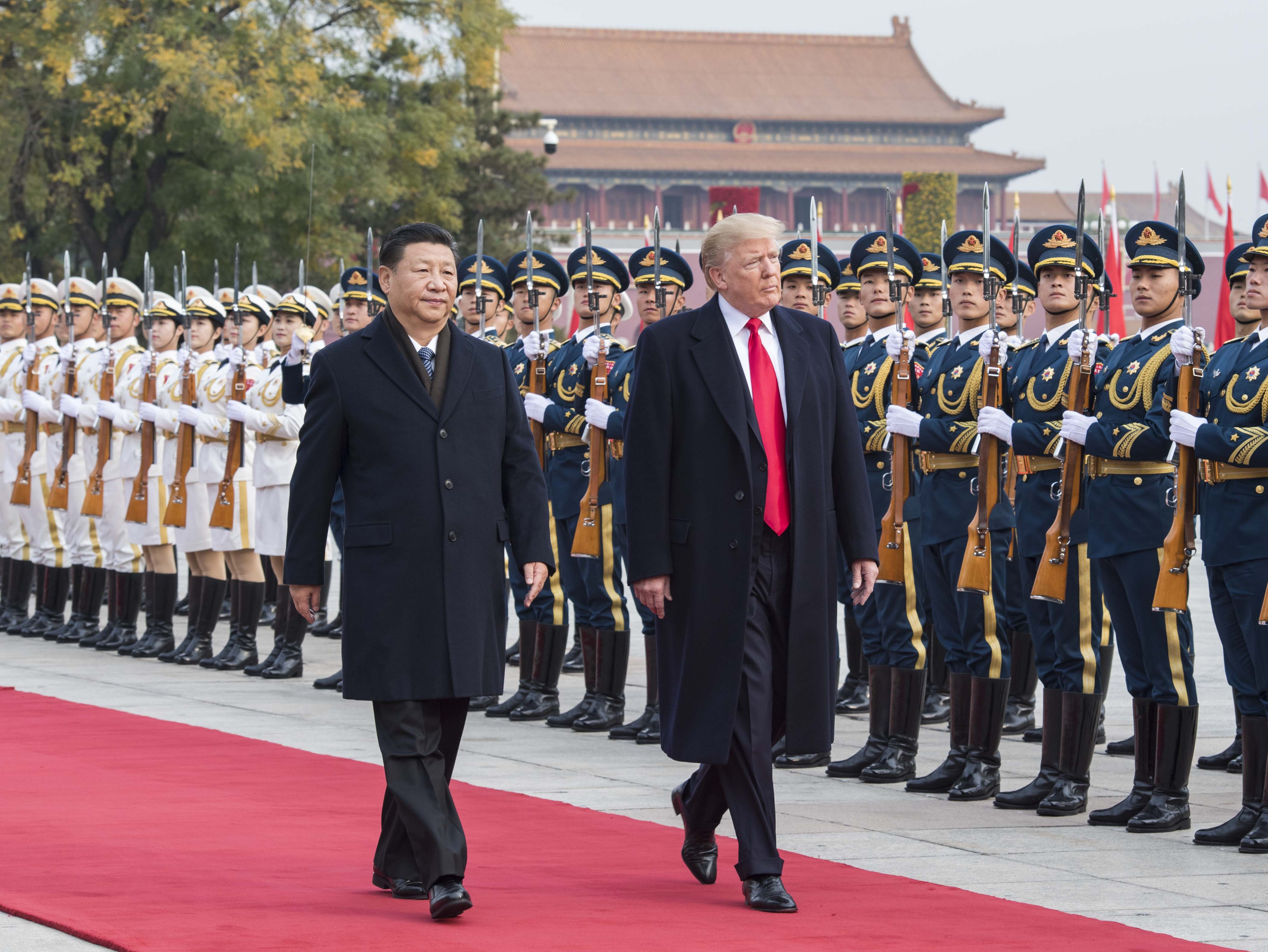 Chinese President Xi Jinping (L) holds a grand ceremony to welcome U.S. President Donald Trump at the square outside the east gate of the Great Hall of the People in Beijing, China, on Nov. 9, 2017.