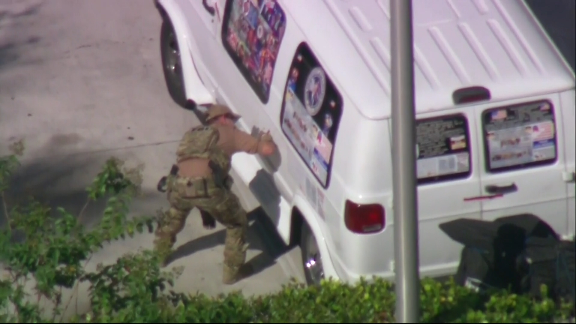 Authorities are seen in Plantation, Florida taking a man into custody in connection to the mailed package bombs.