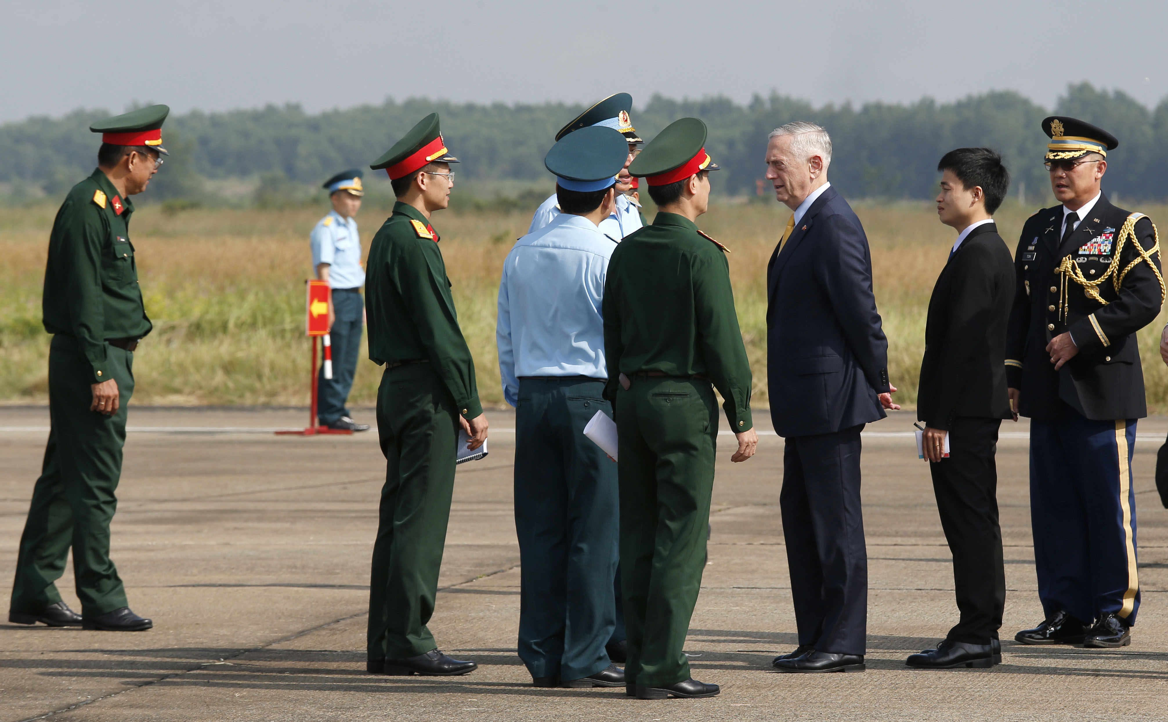 U.S. Defense Secretary Jim Mattis talks to Vietnamese military officials as he visits Bien Hoa airbase, where the US army stored the defoliant Agent Orange during the Vietnam War, in Bien Hoa city, on the outskirts of Ho Chi Minh city, on October 17, 2018.