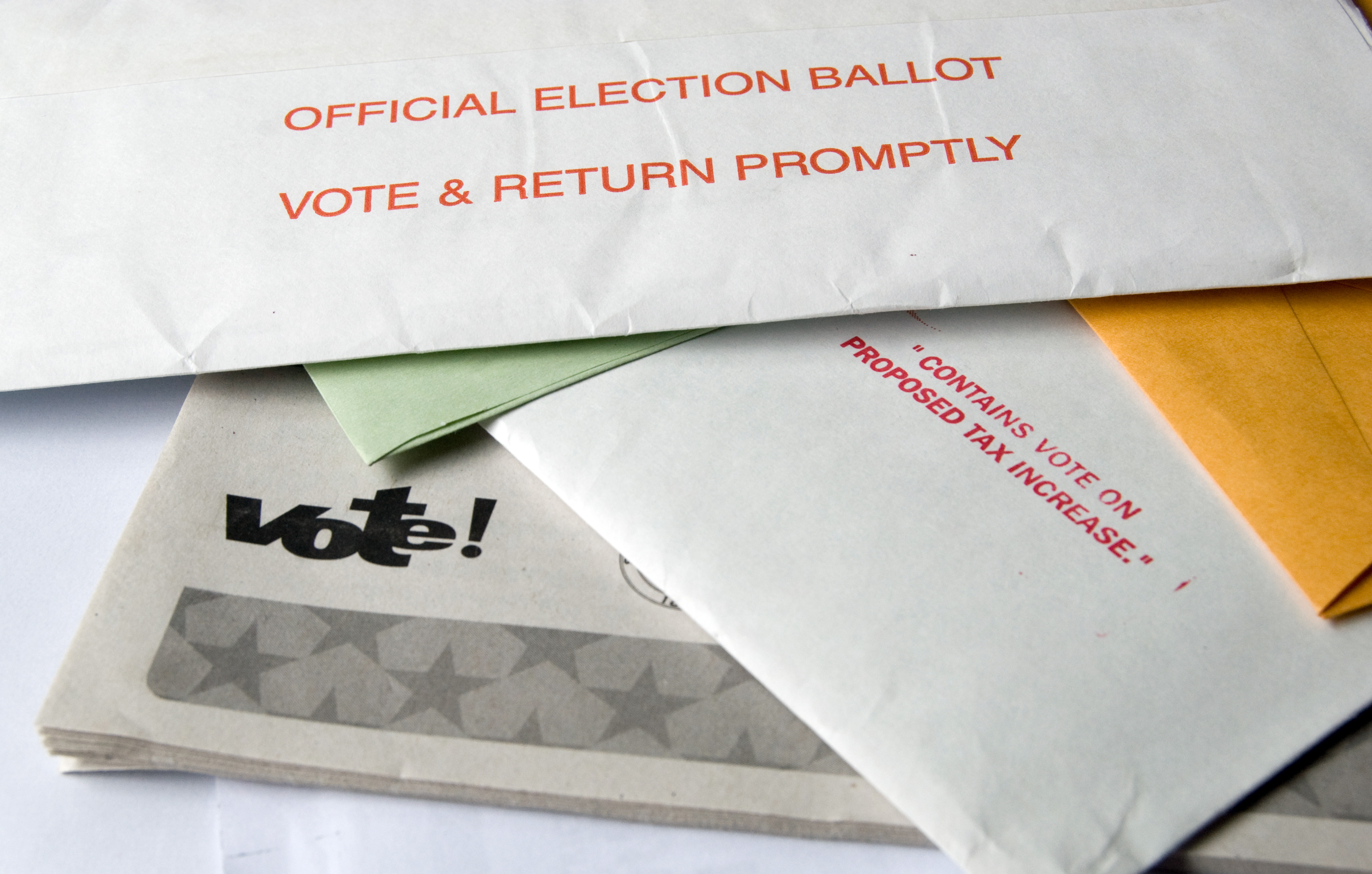 Pile of mail with voting & ballot info.