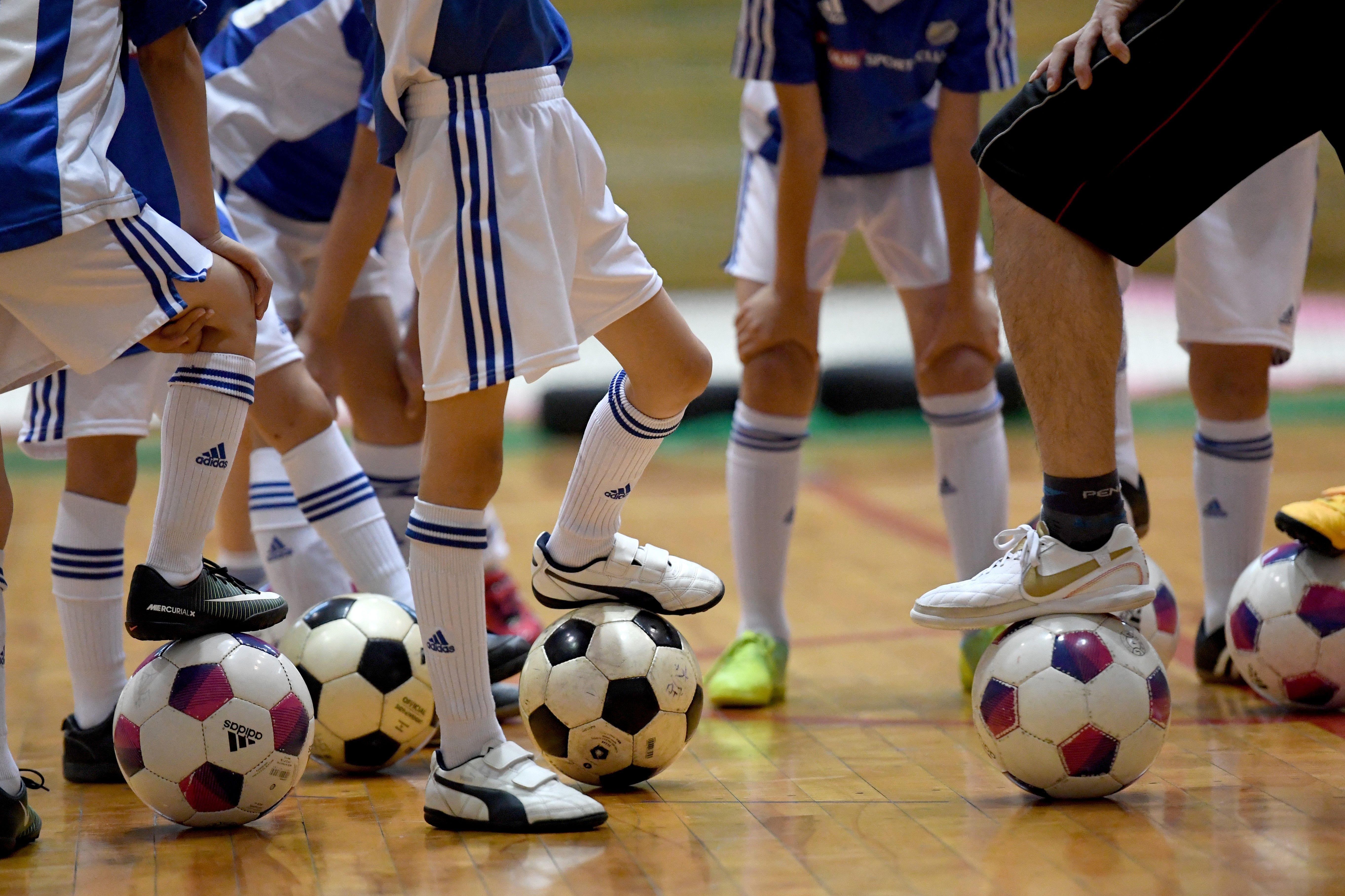 Elementary school children attending a kids soccer school class at Konami Sports Club headquarters in Tokyo.