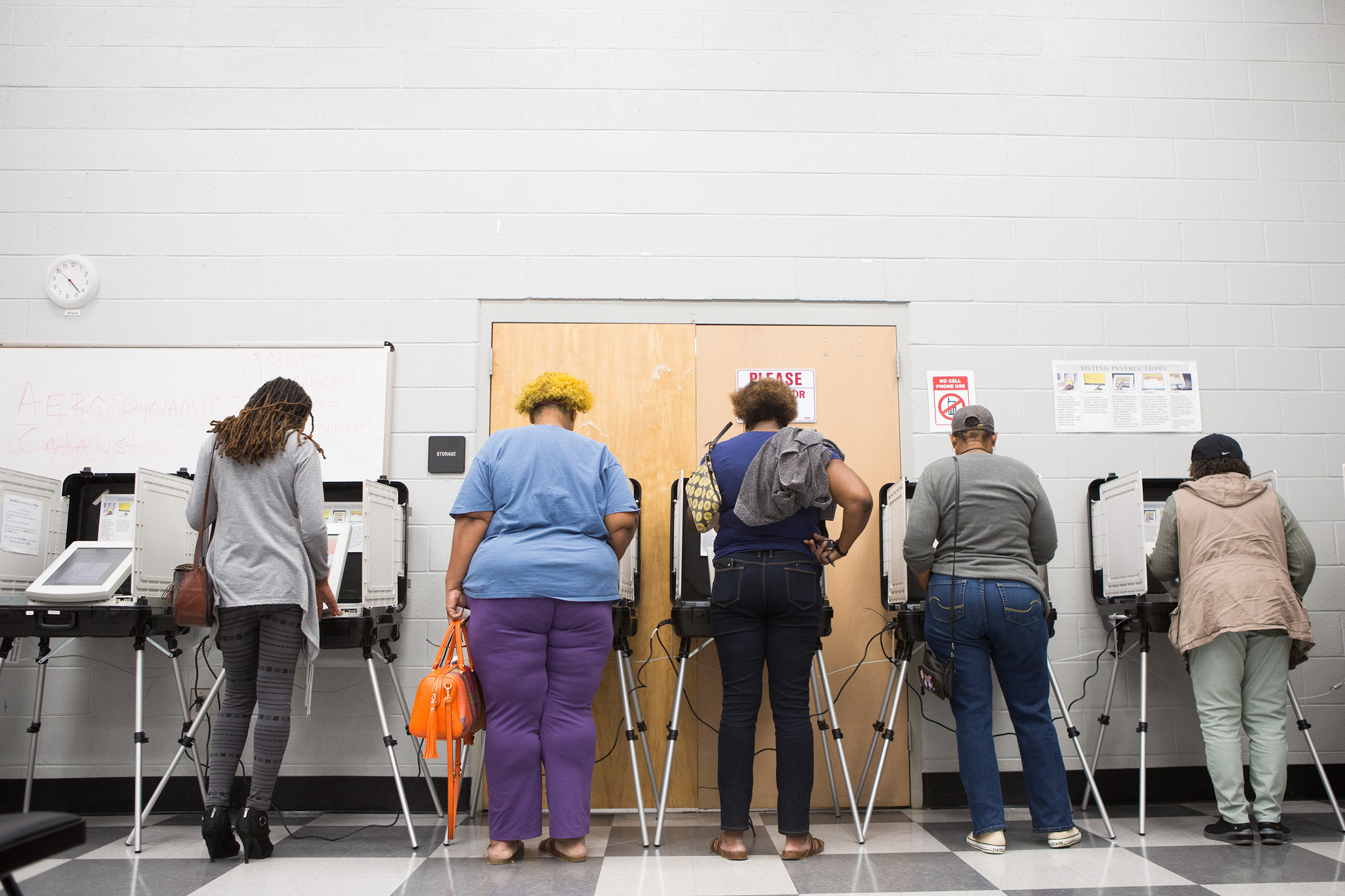 Voters cast their ballots during early voting in Atlanta on Oct. 18