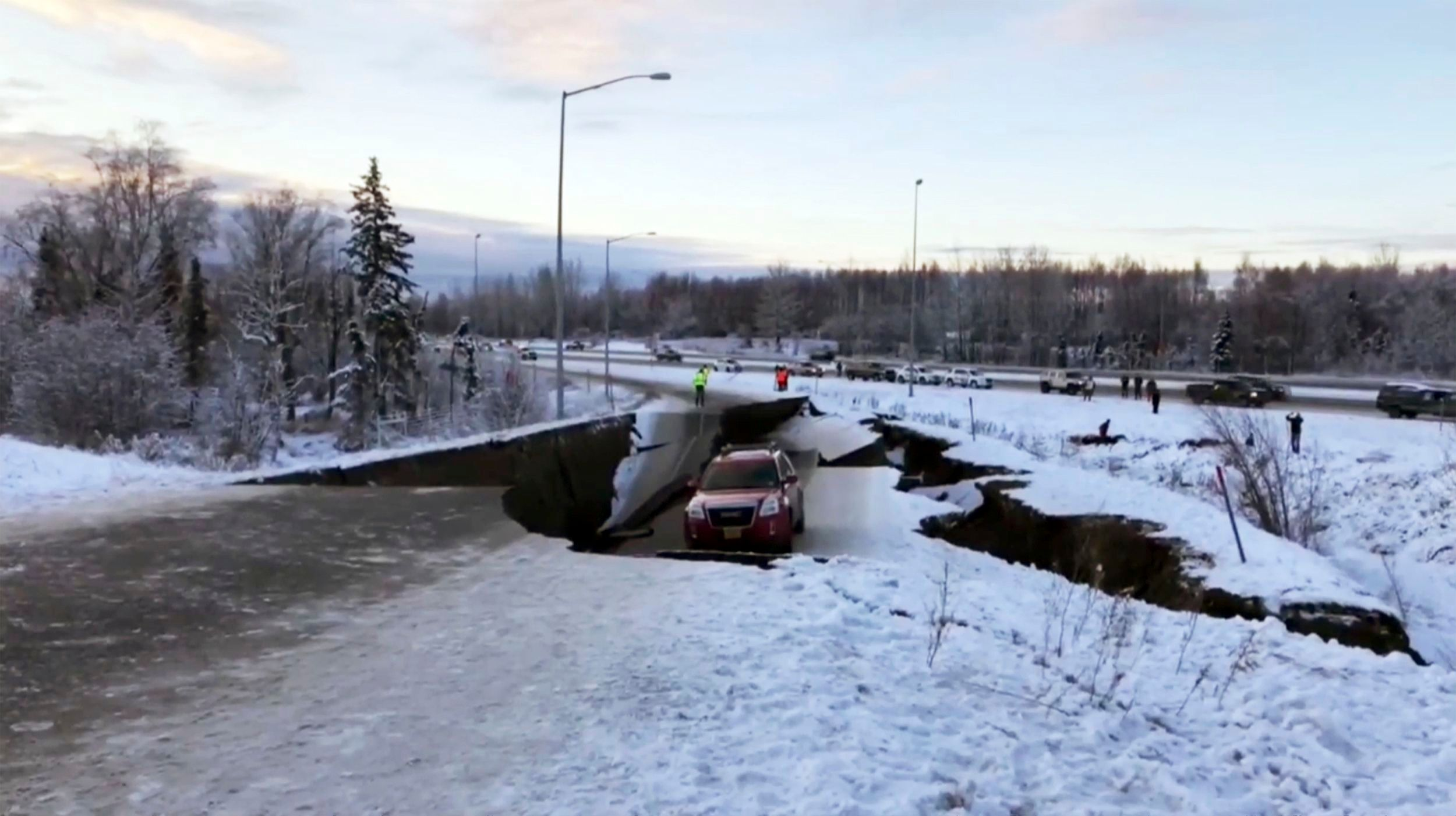 A car is trapped on a collapsed section of the offramp in Anchorage, Alaska on Nov. 30, 2018 after back-to-back earthquakes measuring rocked buildings and buckled roads.