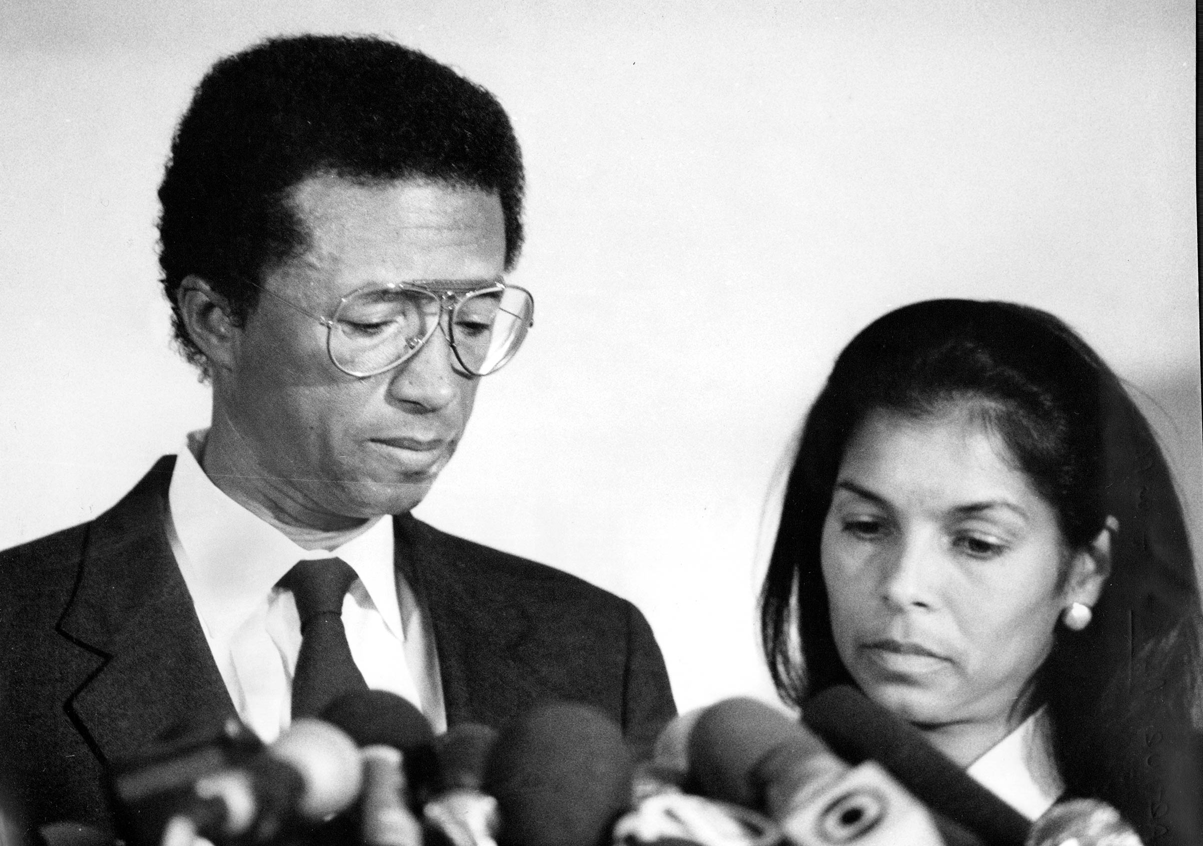 Tennis star Arthur Ashe, accompanied by wife Jeanne, announcing he contracted HIV after a blood transfusion on Apr. 8, 1992, in midtown Manhattan.