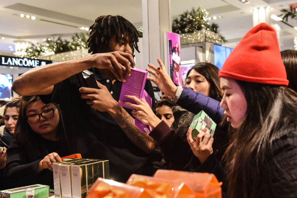 People shop at Macy's department store on  Black Friday  on November 23, 2017 in New York City.