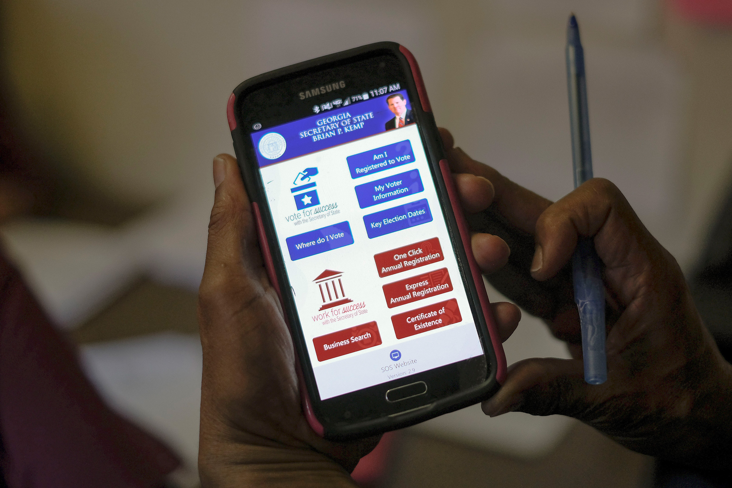 The Georgia SOS app is used by members of Women on the Move to confirm registration and polling precincts with callers at the Urban League of Greater Columbus in Columbus, Ga. on election day, Nov. 6, 2018.