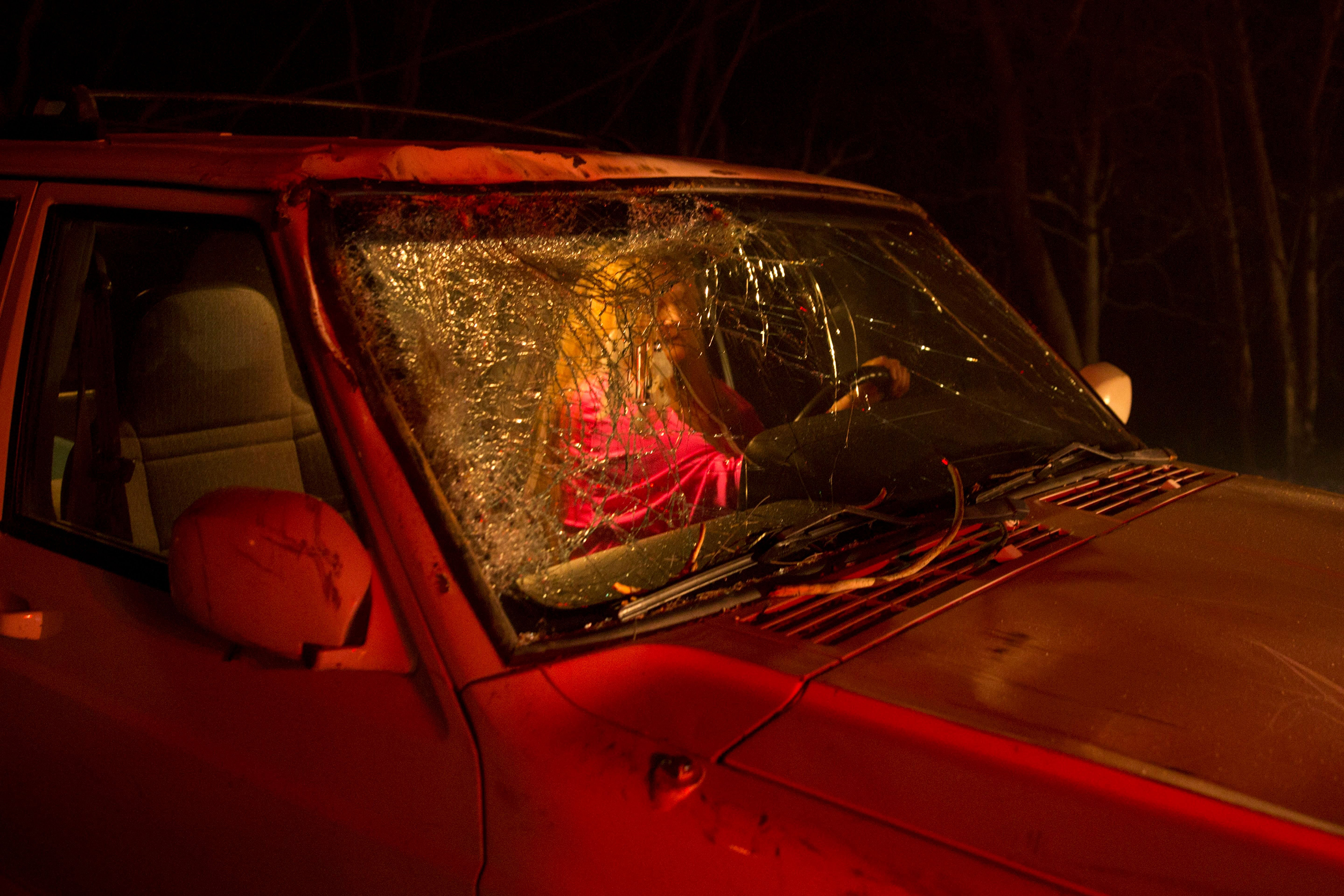 The unidentified driver who narrowly survived after a large tree fell on to the road and cracked the windshield during the Camp Fire, as it burned out of control through Paradise, Calif. on Nov. 8.
