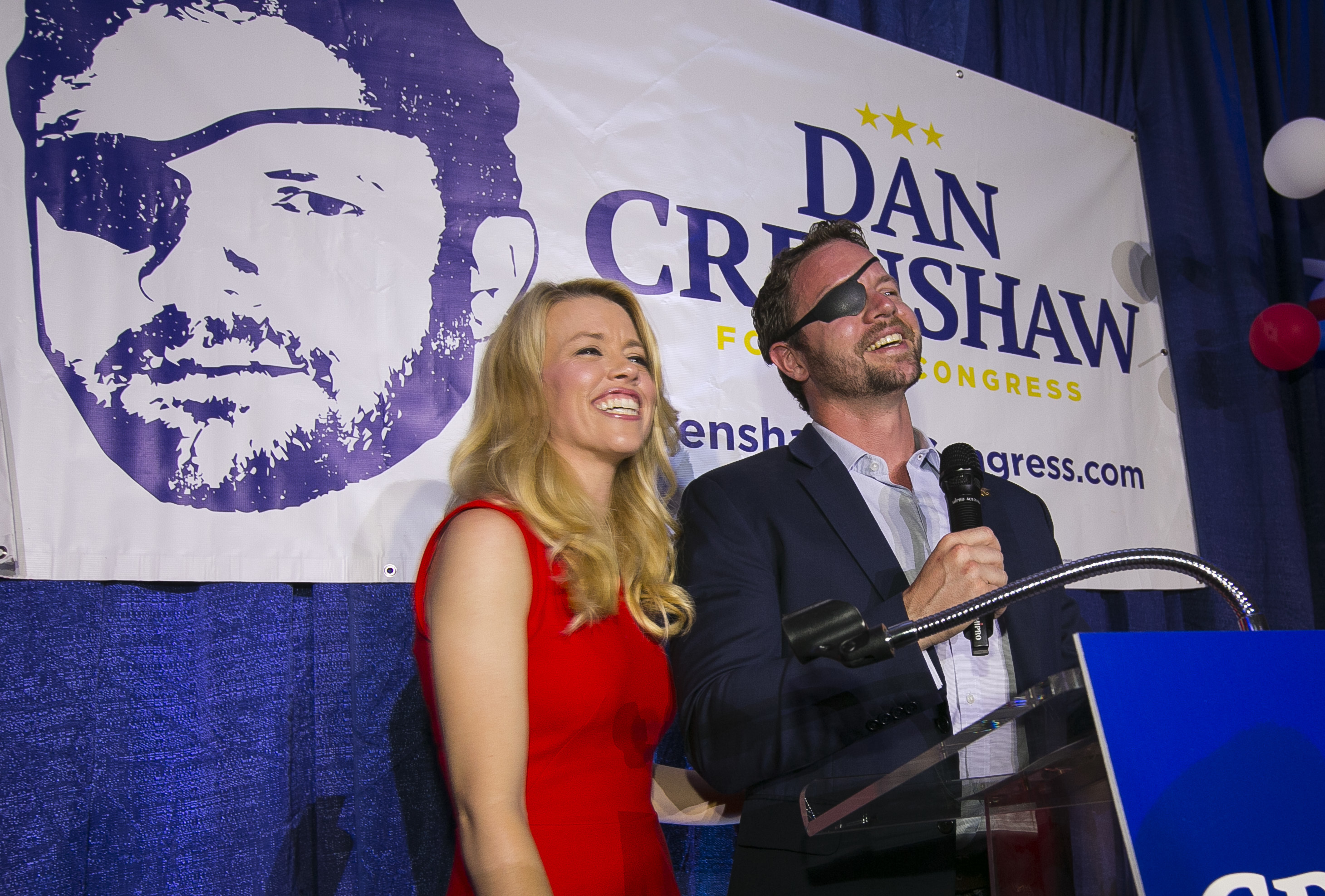 "Republican congressional candidate Dan Crenshaw reacts to the crowd with his wife, Tara, as he comes on stage to deliver a victory speech during an election night party at the Cadillac Bar, in Houston. Crenshaw has chided ""Saturday Night Live"" comic Pete Davidson for poking fun of the eyepatch he wears because he was badly wounded during his third tour in Afghanistan as a Navy SEAL."