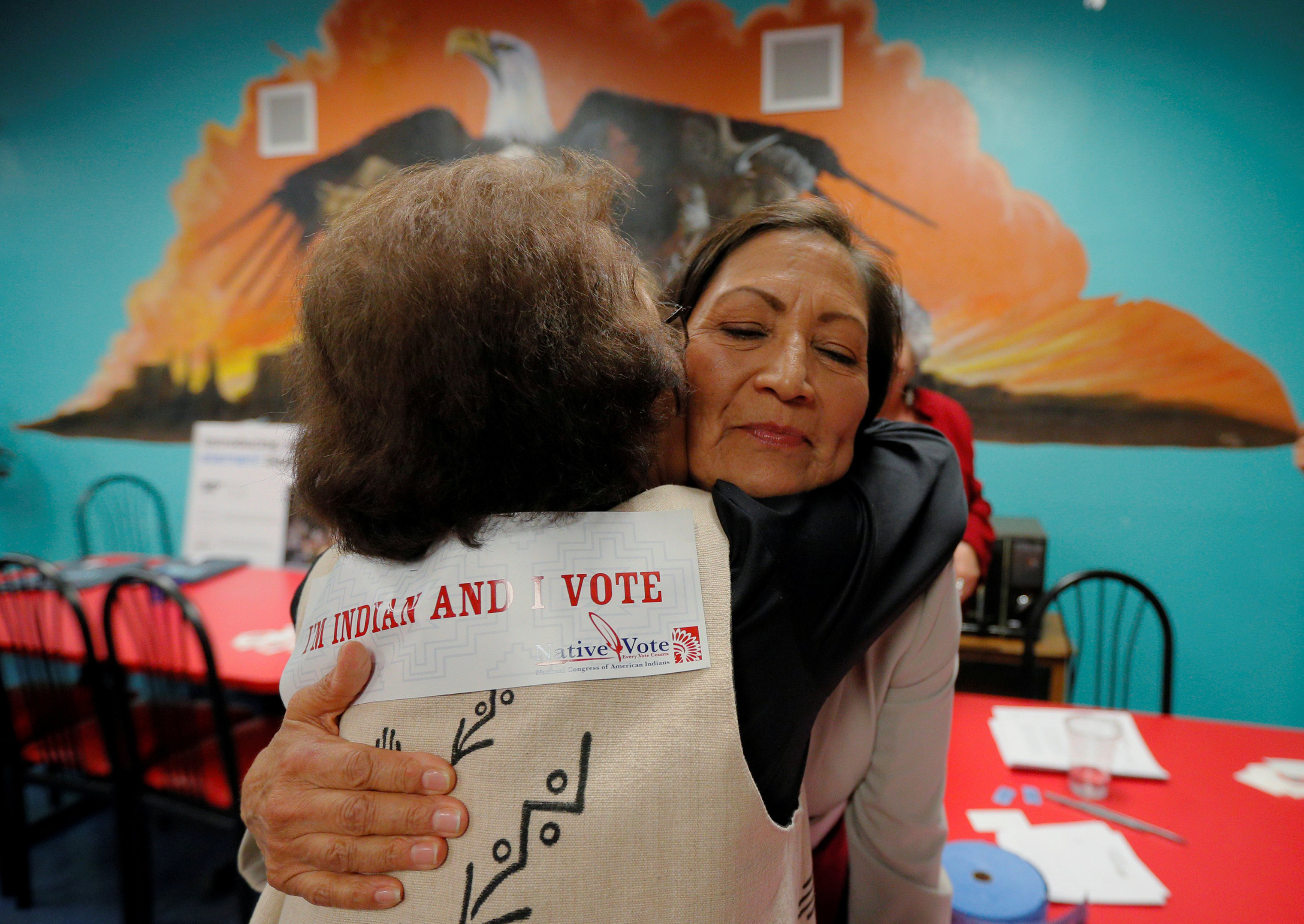 U.S. Democratic Congressional candidate Deb Haaland, who is trying to become the first Native American woman in the U.S. House of Representatives, hugs Dottie Tiger at a Native Vote Celebration on Election Night in Albuquerque, N.M.