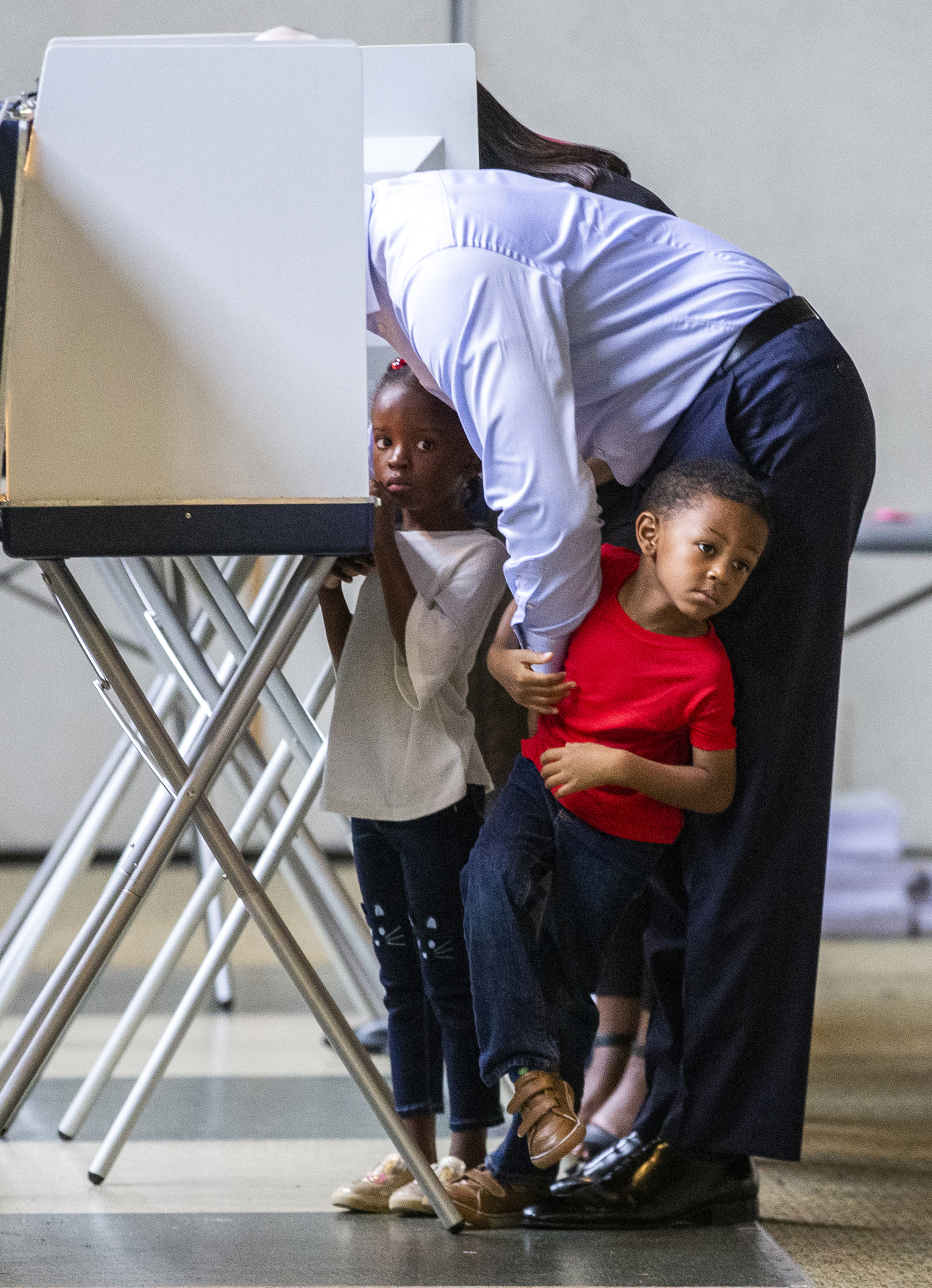 Tallahassee mayor and Democratic gubernatorial candidate Andrew Gillum casts his ballot with his four-year-old twins Caroline, left, and Jackson in Tallahassee, Fla.