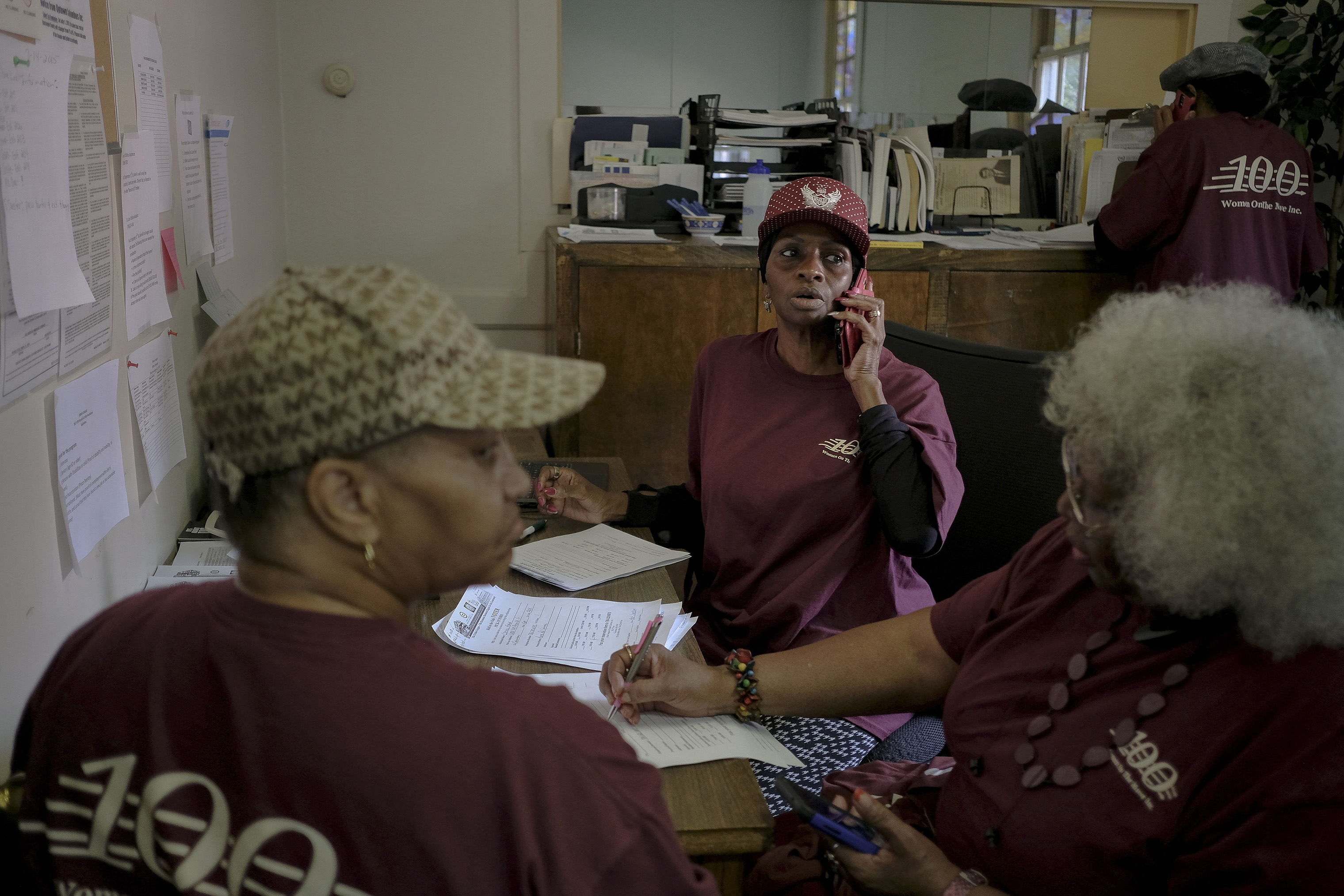 Members of Women on the Move confirm registration and polling precincts with callers at the Urban League of Greater Columbus in Columbus, Ga. on election day, Nov. 6, 2018.