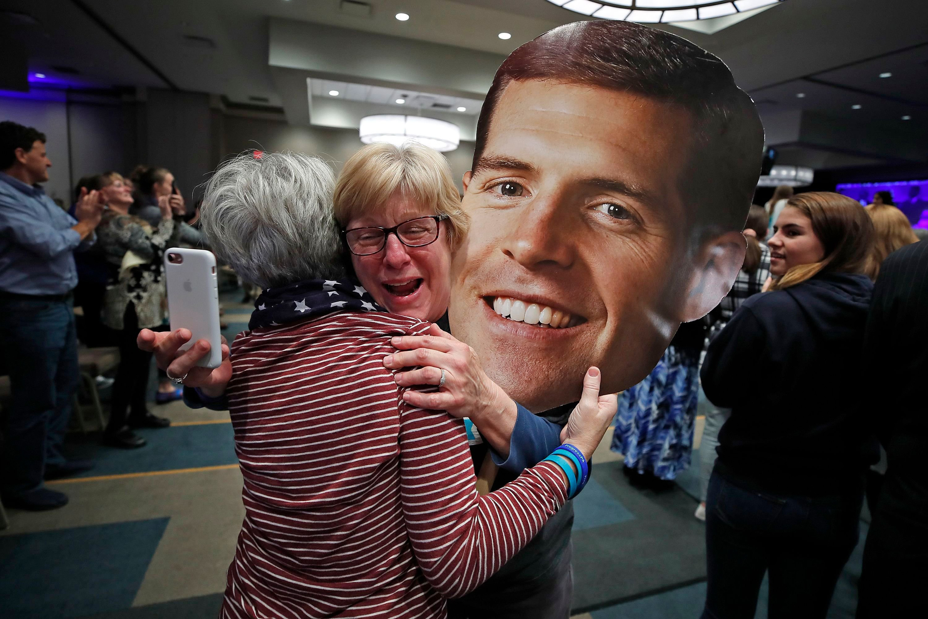 Supporters of Rep. Conor Lamb, Joanie Foran, left, and Linda Bishop, begin to celebrate after hearing CNN projected Lamb the winner in Pennsylvania's 17th Congressional District, at his election night party in Cranberry, Pa.