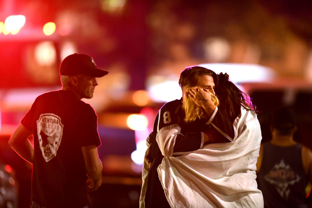 Witnesses console each other near the Borderline Bar & Grill after a shooter wounded seven Wednesday night on November 8, 2018 in Thousand Oaks, California.