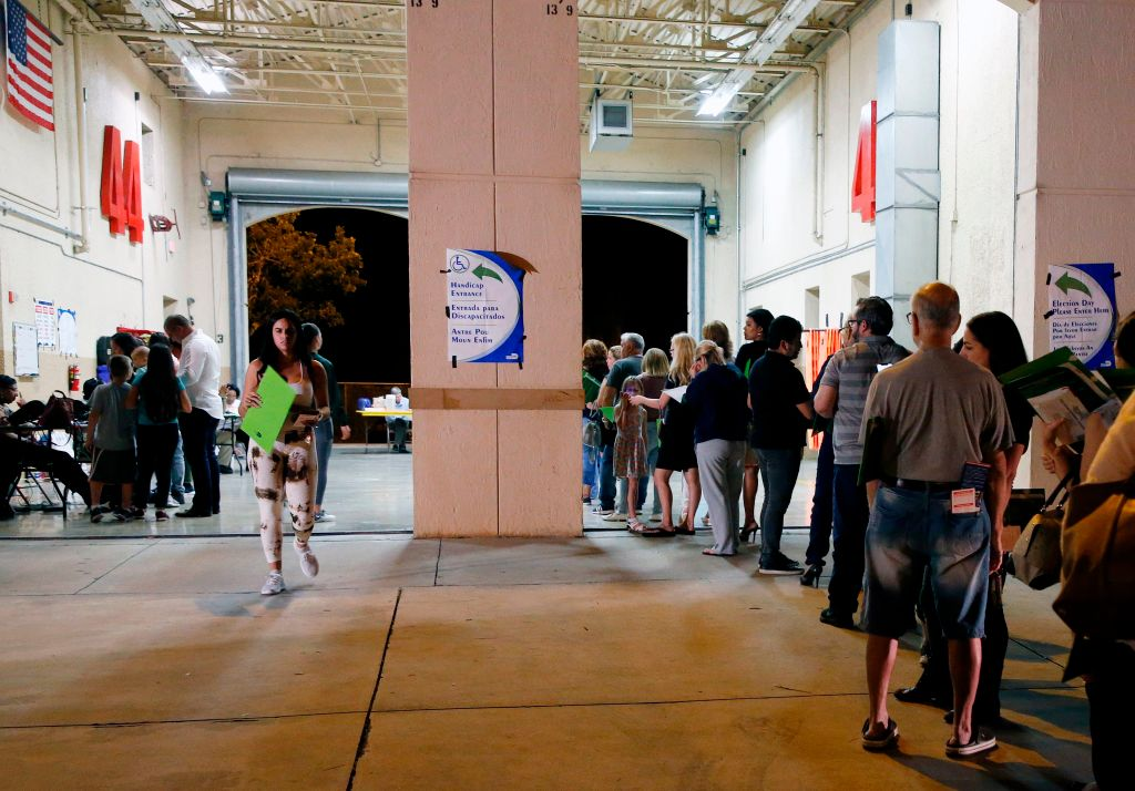 People wait in line to vote at a polling station in Miami, Florida, late on November 6, 2018. Florida passes Amendment 4 to let 1.5 million convicted felons restore their voting rights.