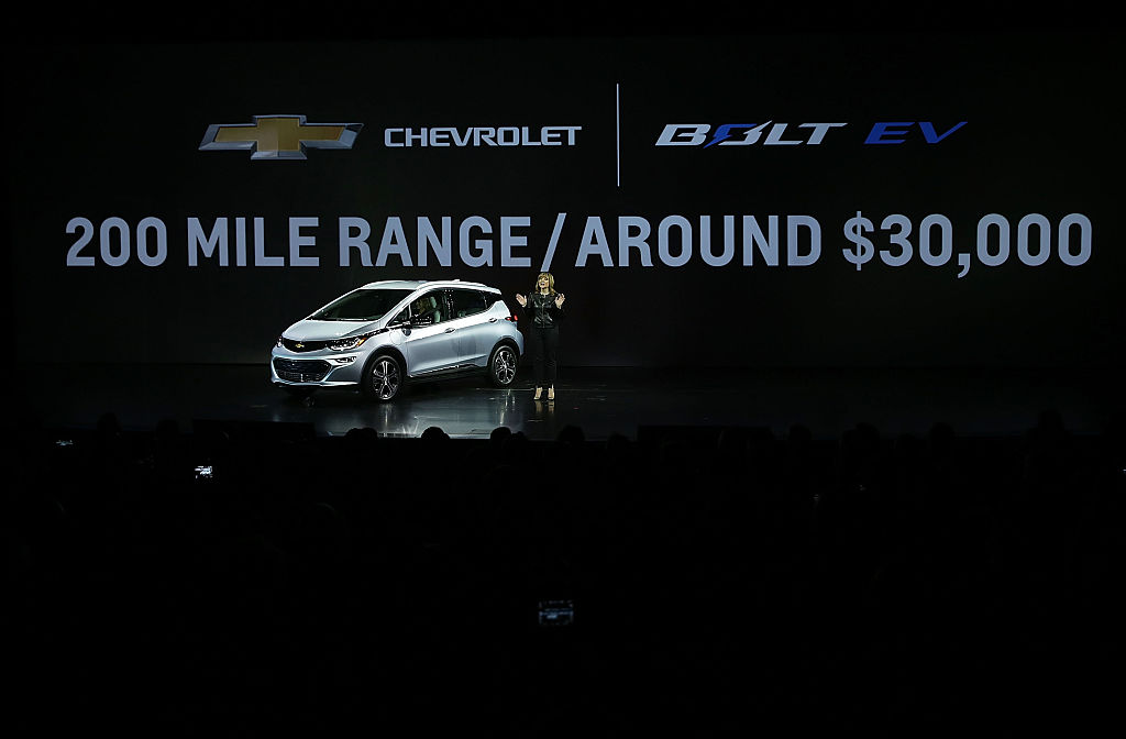 In this January 6, 2016 file photo, General Motors Co. Chairman and CEO Mary Barra introduces the Chevy Bolt EV, an electric car, in Las Vegas, Nevada. In light of GM's announcement of factory closures and thousands of layoffs, President Trump said he may try to eliminate government subsidies for GM electric cars.