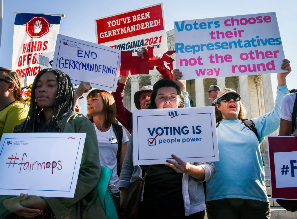 In this Oct. 3, 2017 file photo, protestors wait in front of the Supreme Court while the Justices hear arguments on gerrymandering, on in Washington, D.C.