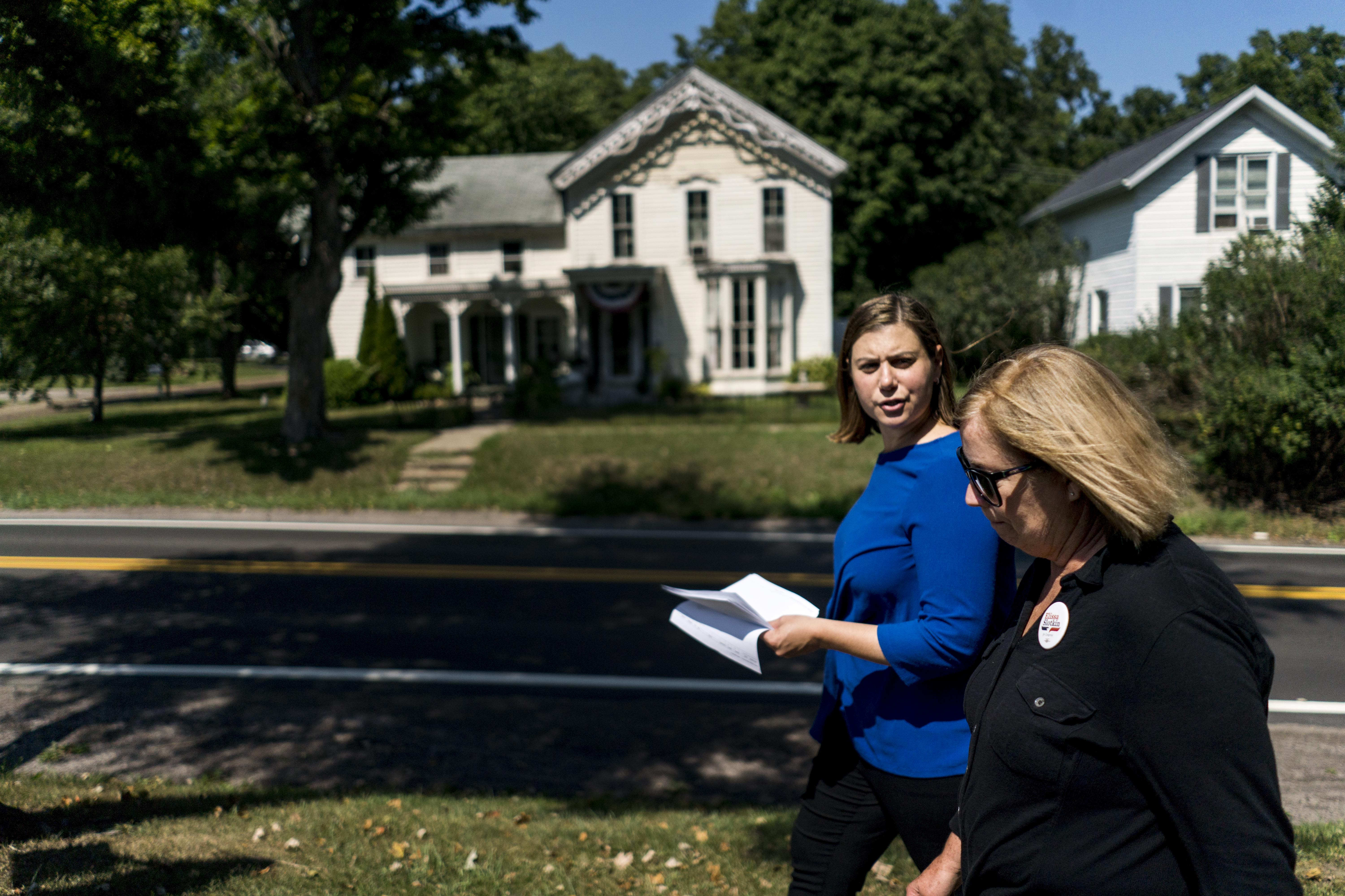 HOLLY, MICHIGAN - Elissa Slotkin, left,  Democratic candidate seeking election to the U.S. House to represent Michigan District 8, canvasses door to door with campaign volunteer Karen More near Holly, Michigan. (Photo by Melina Mara/The Washington Post --Getty Images)