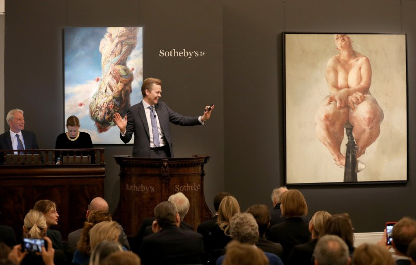 Oliver Barker, Chairman of Sotheby's Europe, fields bids for Jenny SavilleÕs 1992 painting 'Propped', the work that propelled her to international acclaim at Sotheby's Contemporary Art Evening Auction at Sotheby's on October 5, 2018 in London, England. The painting sold tonight at SothebyÕs in London for £9.5m / $12.4 million / Û10.8 million, setting a new auction record for a work by a living female artist. The painting was part of the collection of David Teiger, visionary collector and patron of the arts. Proceeds from this and from other works from his collection will benefit the Teiger Foundation, soon to be one of the worldÕs largest and most significant contemporary art foundations.
