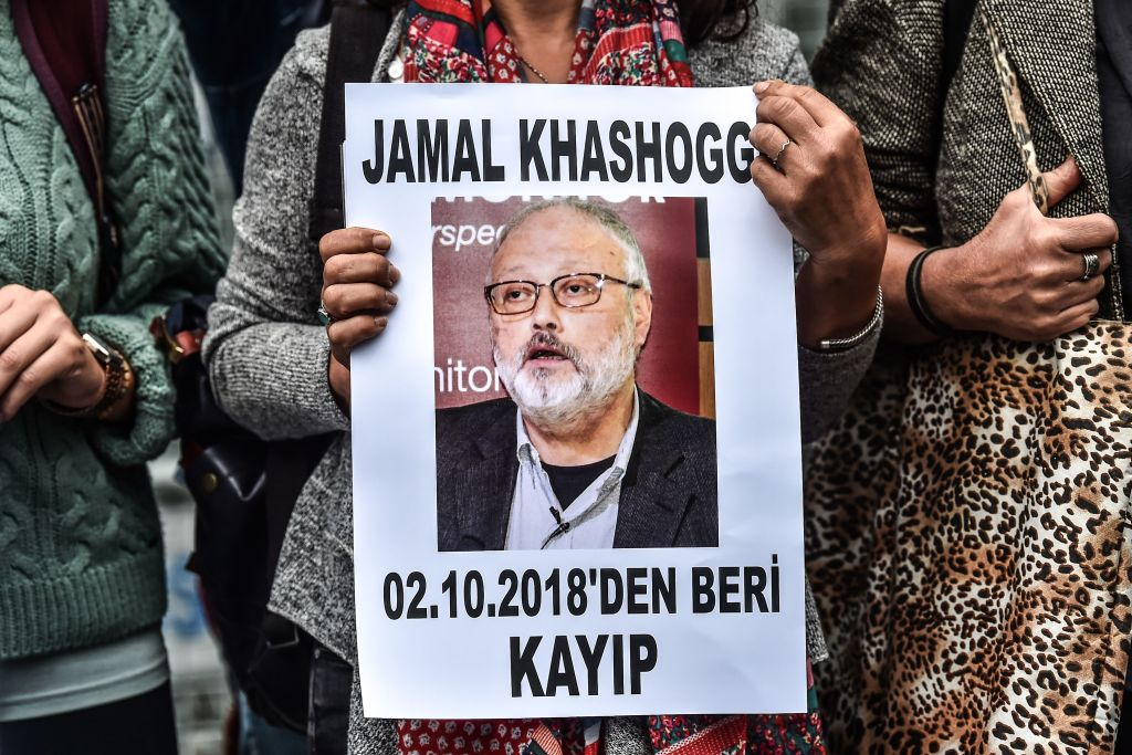 A woman holds a portrait of missing journalist and Riyadh critic Jamal Khashoggi reading  Jamal Khashoggi is missing since October 2  during a demonstration in front of the Saudi Arabian consulate in Istanbul on Oct. 9, 2018.