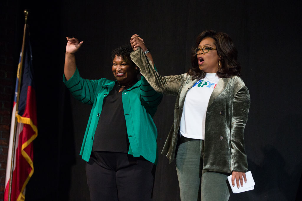 Oprah Winfrey and Georgia Democratic gubernatorial candidate Stacey Abrams at a town hall style event at the Cobb Civic Center  in Marietta, Georgia on Nov. 1, 2018.