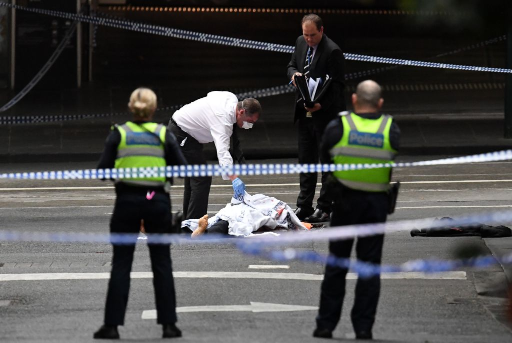 A police officer inspects the crime scene following a stabbing incident in Melbourne, Australia on Nov. 9, 2018.