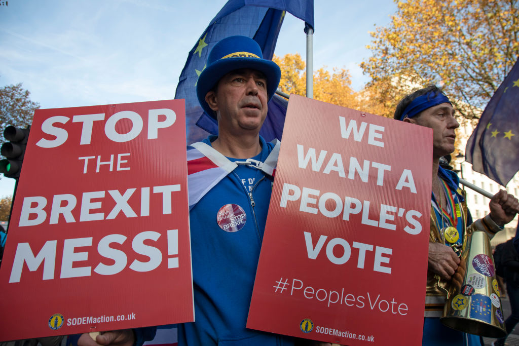 Anti-Brexit demonstrator Stephen Bray protests opposite Downing Street on the day the Prime Minister takes her draft Brexit deal to gain backing from her cabinet in Westminster on Nov.14 in London, United Kingdom