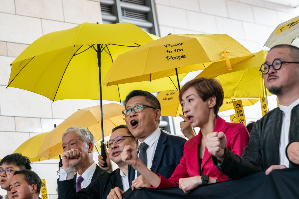 Occupy co-founders Reverend Chu Yiu-ming, Benny Tai and Chan Kin-man protest outside the West Kowloon Court on Nov. 19, 2018 in Hong Kong.
