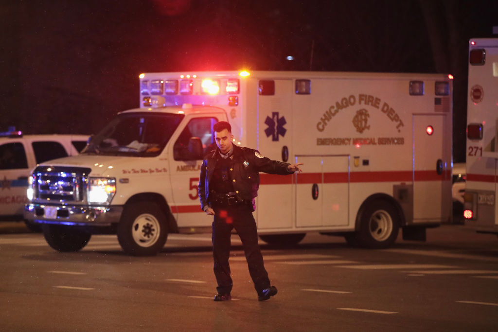 Police secure the scene near Mercy Hospital after a gunman opened fire in Chicago, Ill. in Nov. 19, 2018.