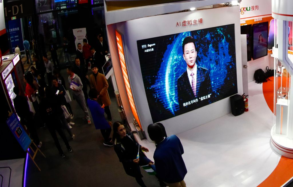An Artificial intelligence (AI) host is seen on the screen during 'Light of Internet' Expo of the 5th World Internet Conference in Wuzhen, China on Nov. 7, 2018.