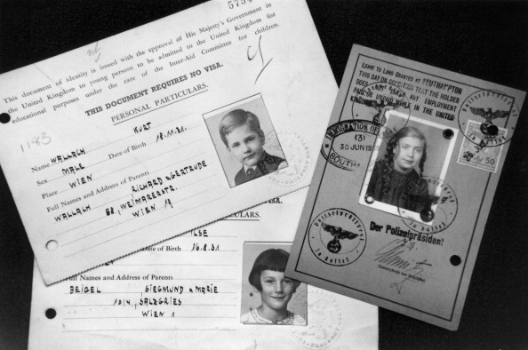 Kindertransport documents, c1939. They show photographs and details for three children who were brought to Britain from Austria to escape the Nazis.