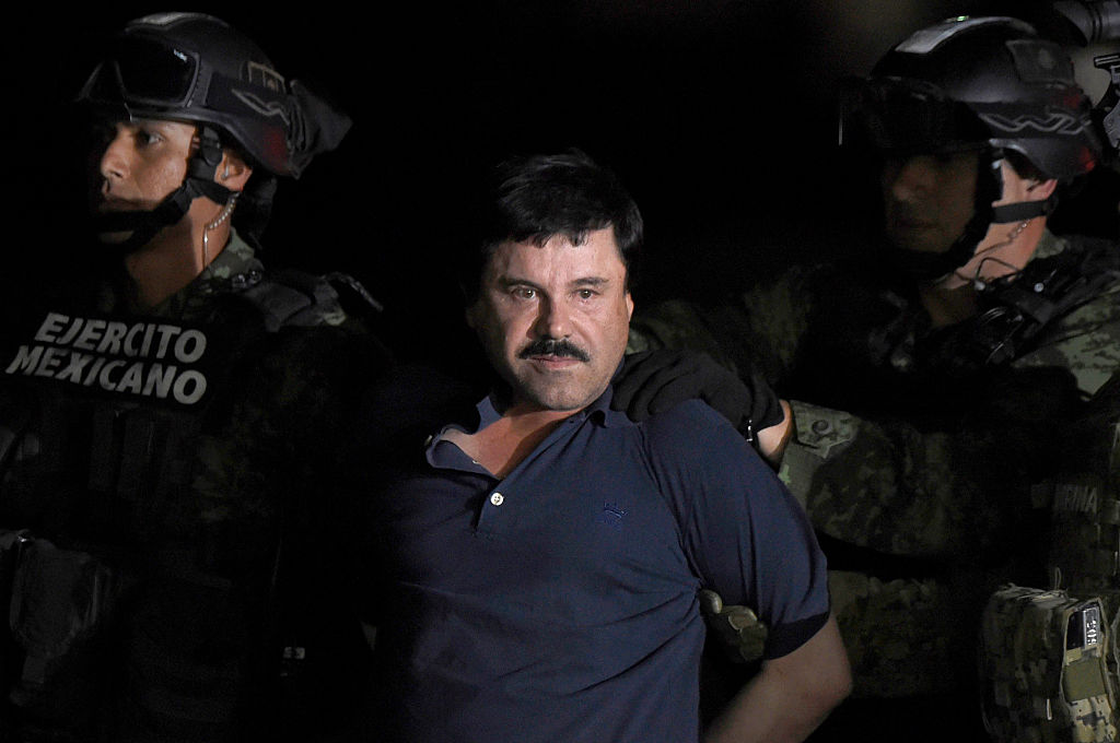 Drug kingpin Joaquin  El Chapo  Guzman is escorted into a helicopter at Mexico City's airport on Jan. 8, 2016.
