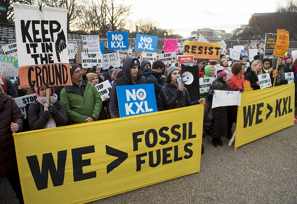 Opponents of the Keystone XL and Dakota Access pipelines hold a rally protesting President Donald Trump's executive orders advancing the projects next to the White House in Washington, D.C. on Jan. 24, 2017.