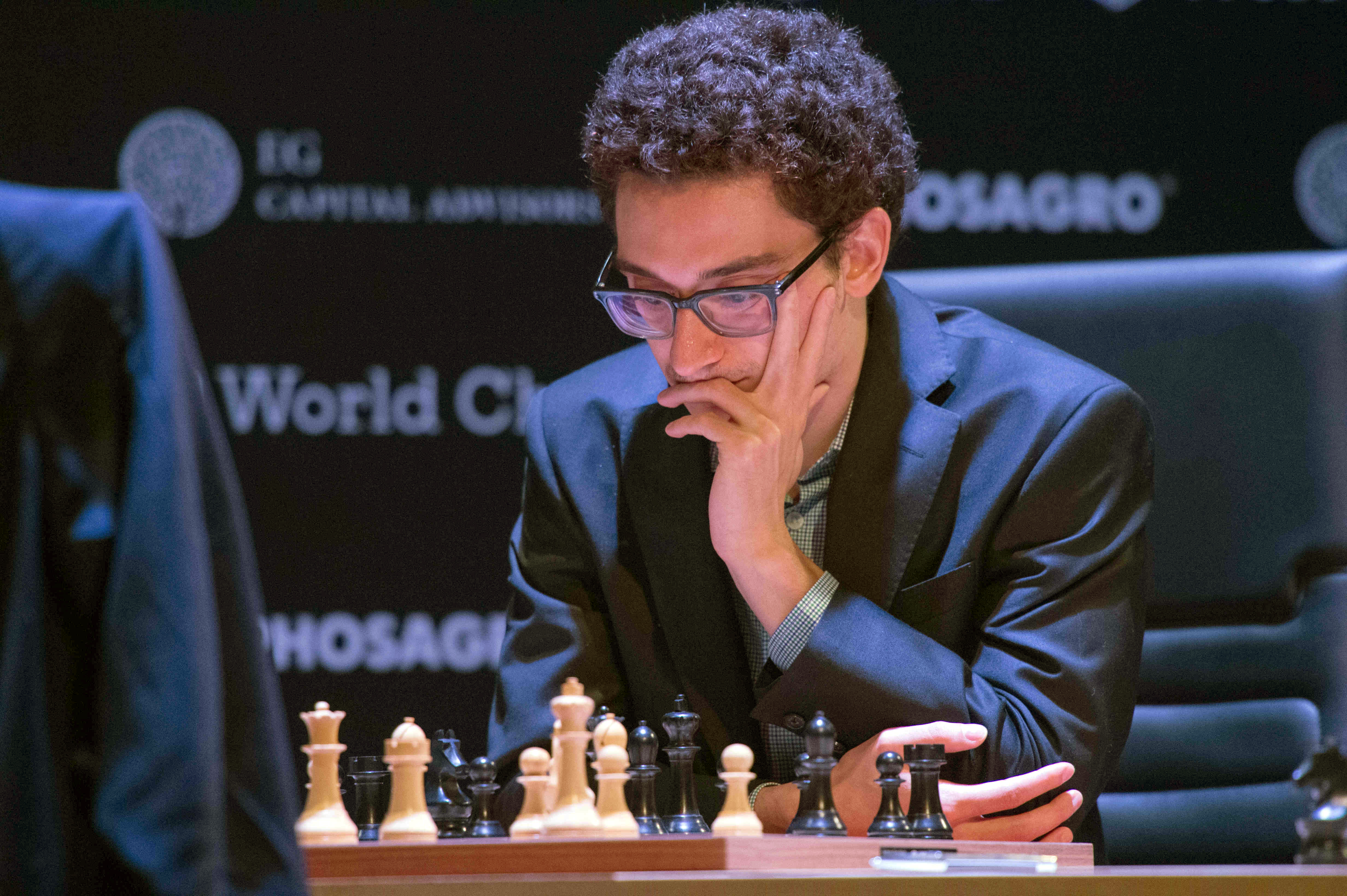 Fabiano Caruana, a US-American and Italian chess grand master, and Grischuk (not pictured), chess grand master of Russia, playing at their boards at the  FIDE World Chess Candidates Tournament  in March 2018. (