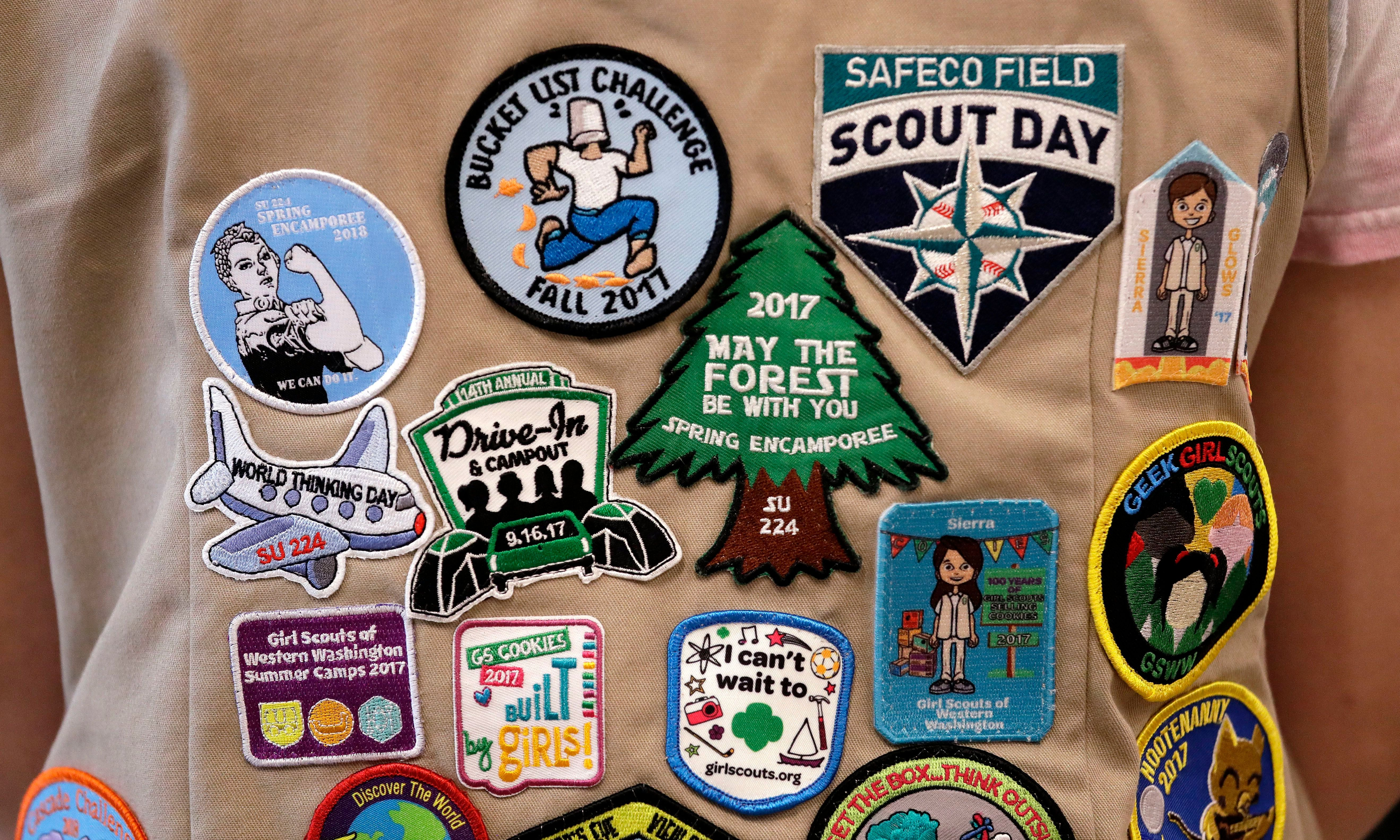In this June 18, 2018 file photo, patches cover the back of a Girl Scout's vest at a demonstration of some of their activities in Seattle.