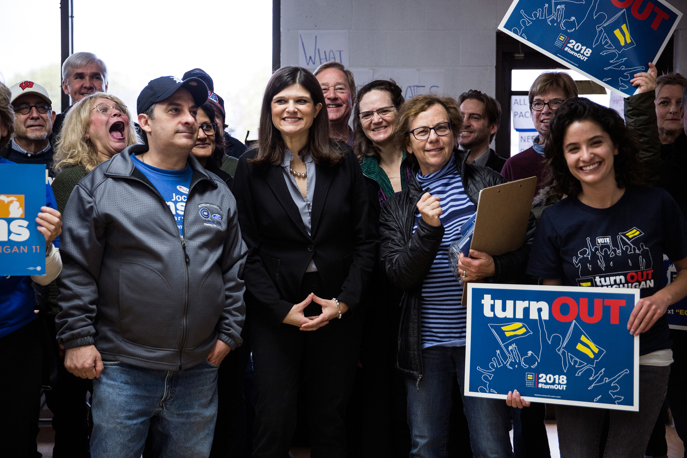 Democratic candidate for Michigan's 11th Congressional District Haley Stevens, center, poses for a picture with supporters and volunteers while launching election day canvassing at Stevens' Field Office in Troy, Mich, on Nov. 6, 2018.