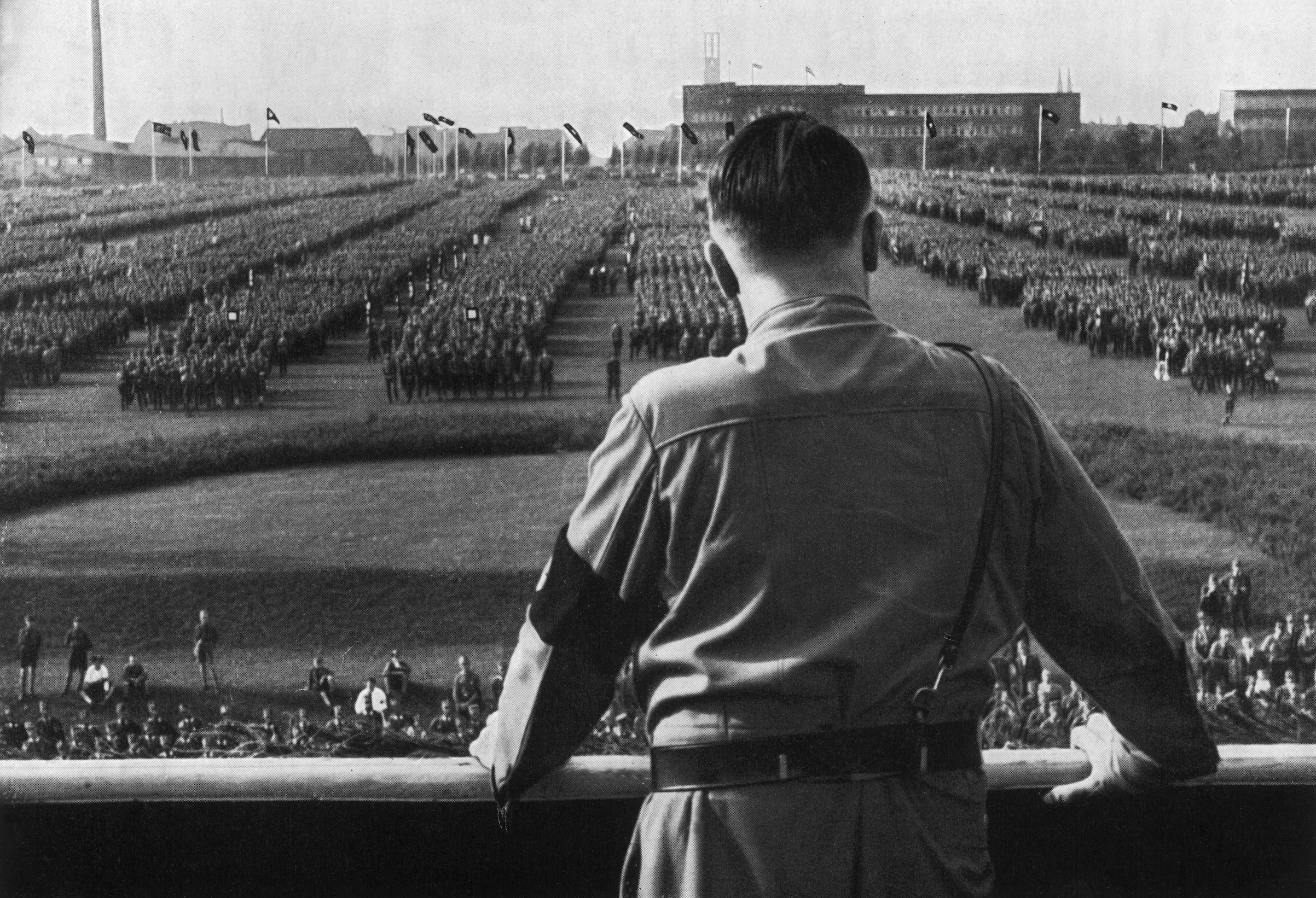 German Fuhrer and Nazi leader Adolf Hitler (1889 - 1945) addresses soldiers with his back facing the camera at a Nazi rally in Dortmund, Germany, in the 1930s.