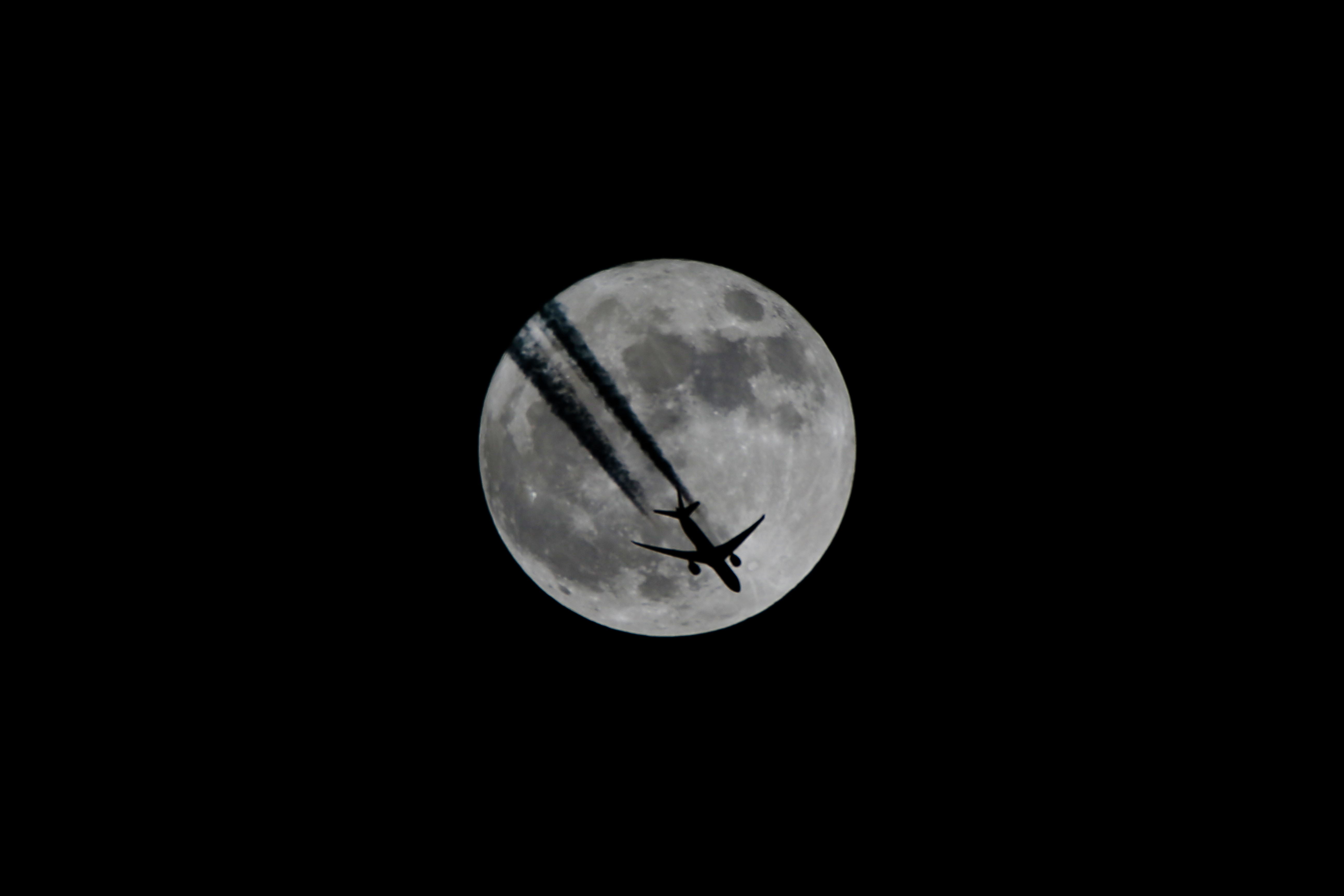 An aircraft flies in front of a full moon in Van, Turkey on December 3, 2017.