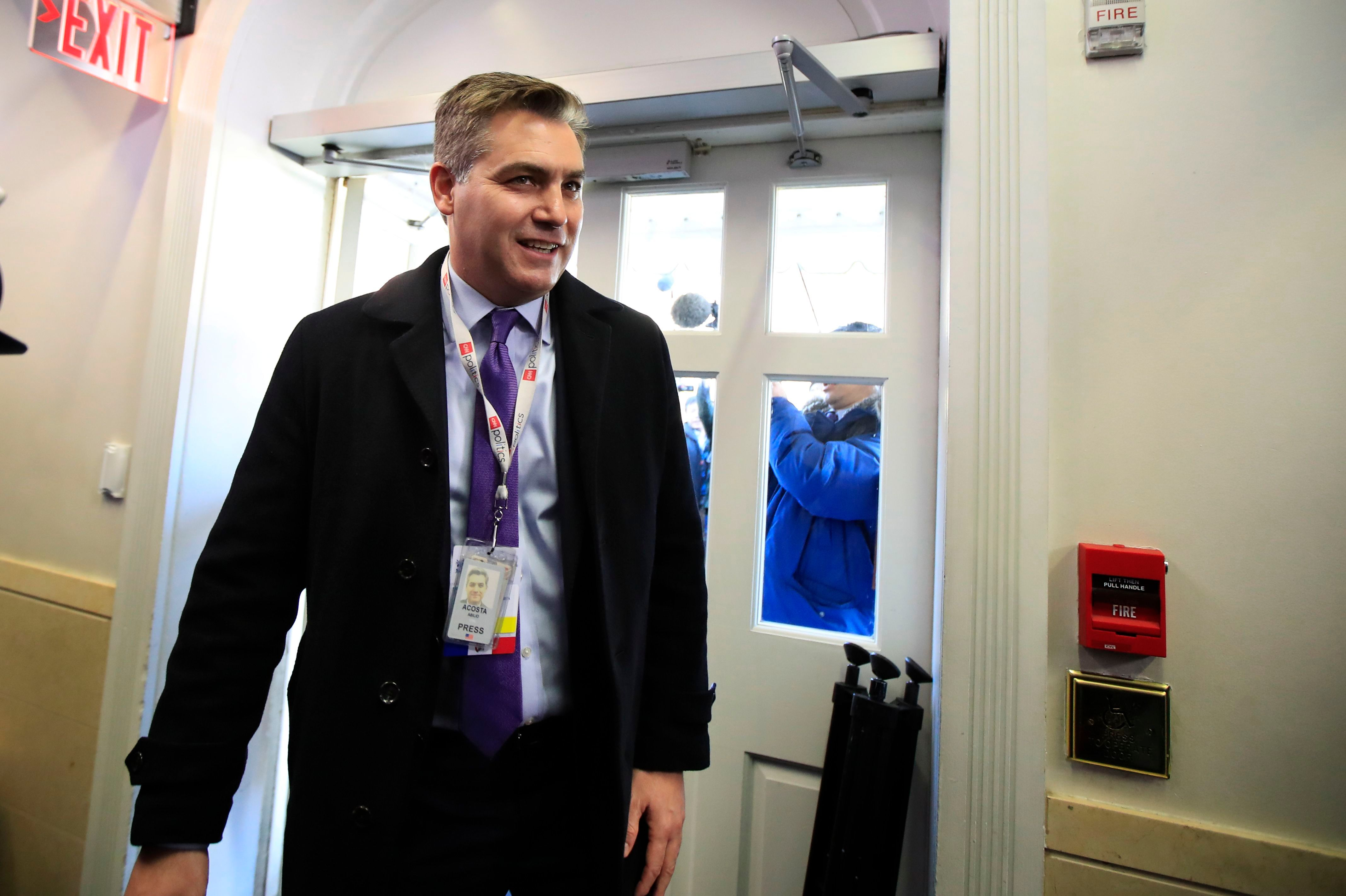 CNN's Jim Acosta enters the Brady press briefing room upon returning back to the White House in Washington on Nov. 16, 2018.