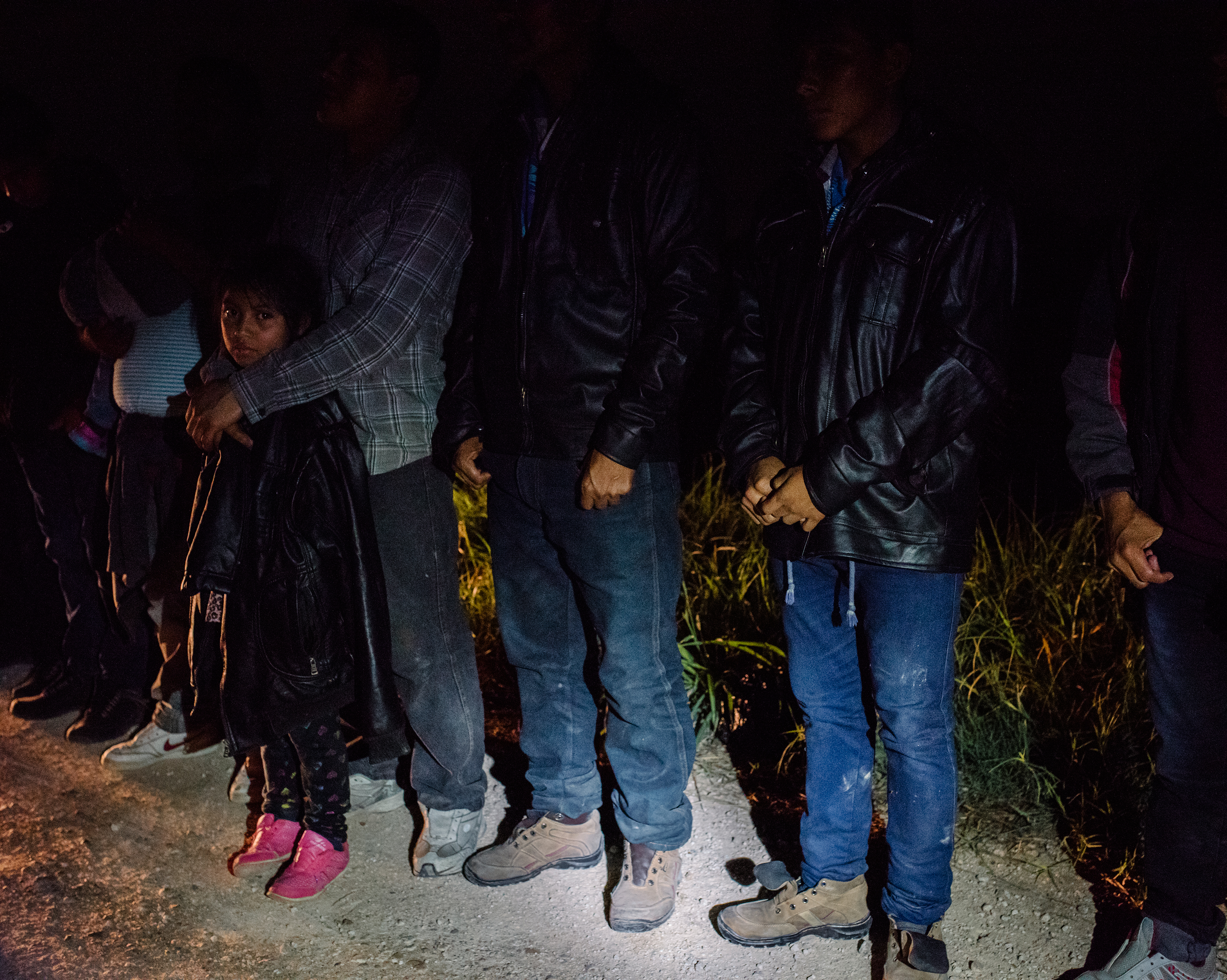 U.S. Border Patrol agents arrest a group of 43 Central American migrants, including children, on a roadside in McAllen, Texas, during a predawn patrol in late September.