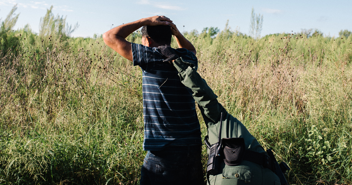 A border officer pats down a migrant from Honduras who had illegally crossed from Mexico to McAllen on Sept. 25.
