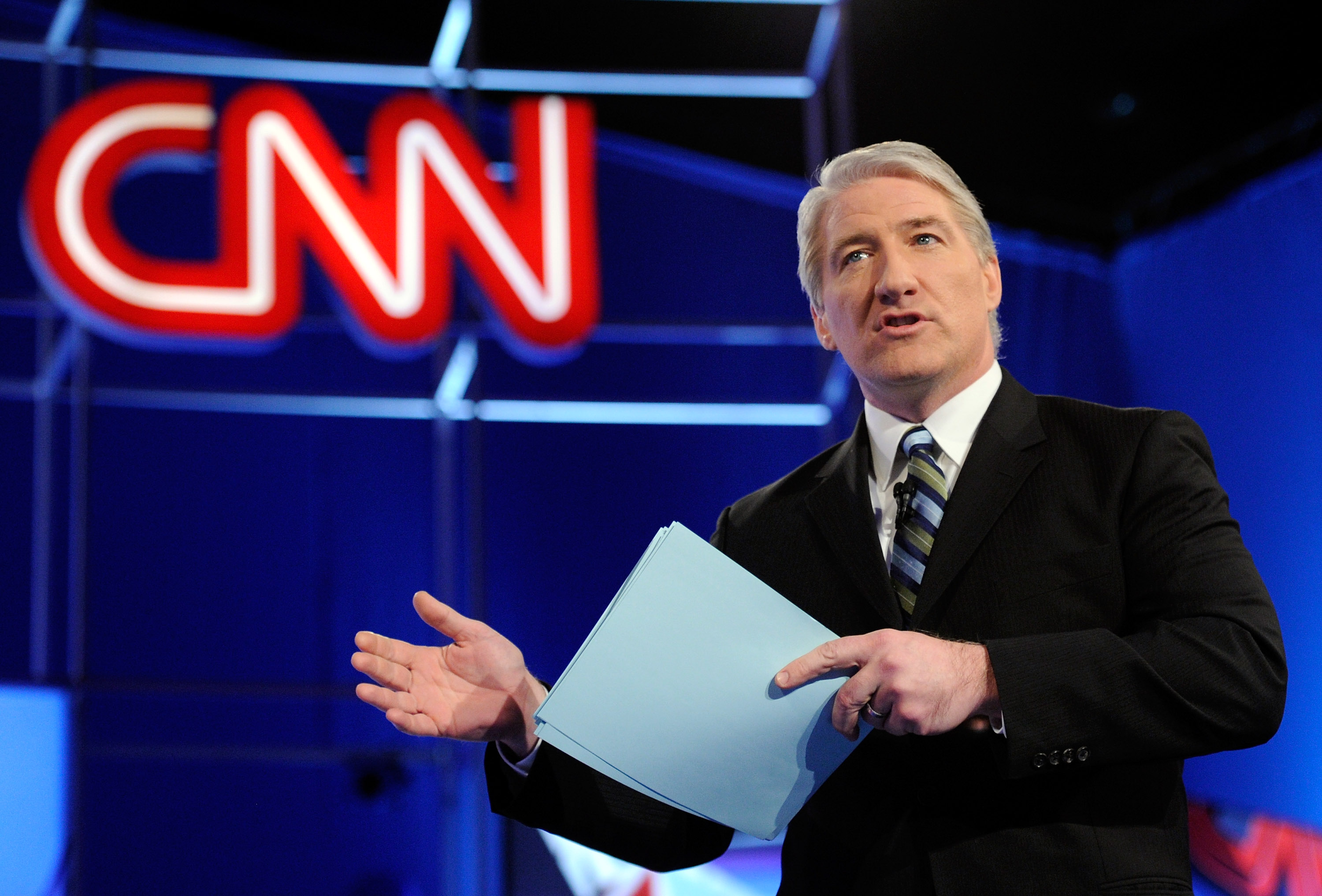 CNN correspondent John King talks to the audience before moderating a debate between Republican presidential candidates on February 22, 2012 in Mesa, Arizona. On Nov. 6, 2018 the CNN correspondent John King was seen walking around aimlessly around the CNN studio during the midterm election.