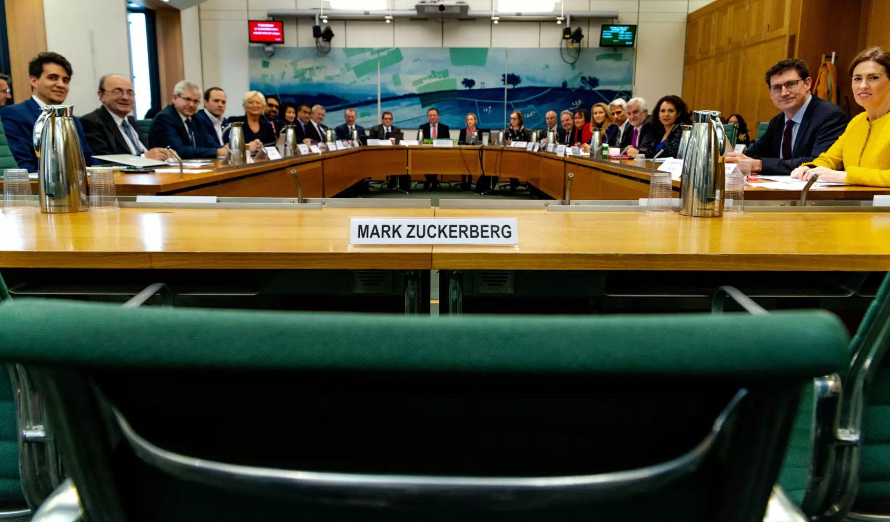 An empty chair represents Mark Zuckerberg's refusal to attend a hearing in the U.K. parliament, where representatives from nine countries gathered to demand answers from Facebook on Nov. 27 in London.