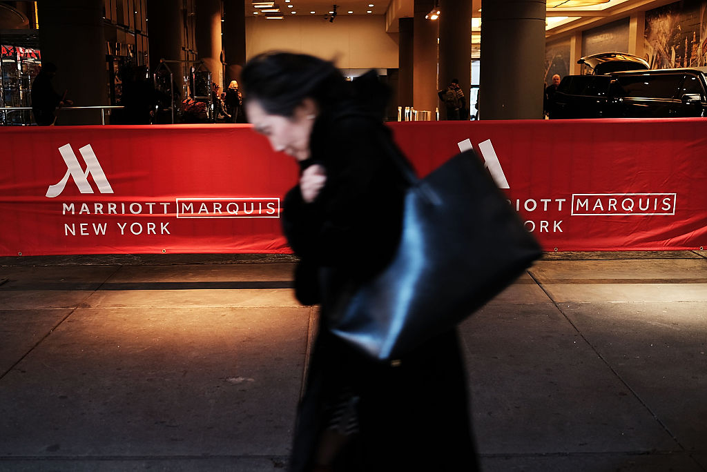 A woman walks by a Marriott hotel in midtown Manhattan on March 21, 2016 in New York City.