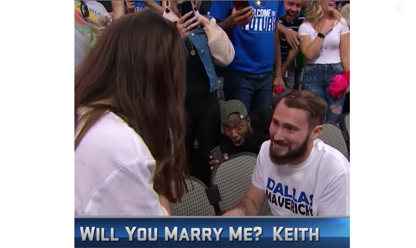 This photo taken from video shows Jonathan Miller's excited reaction to the wedding proposal at the Dallas Mavericks game on Sunday, Oct. 28, 2018.