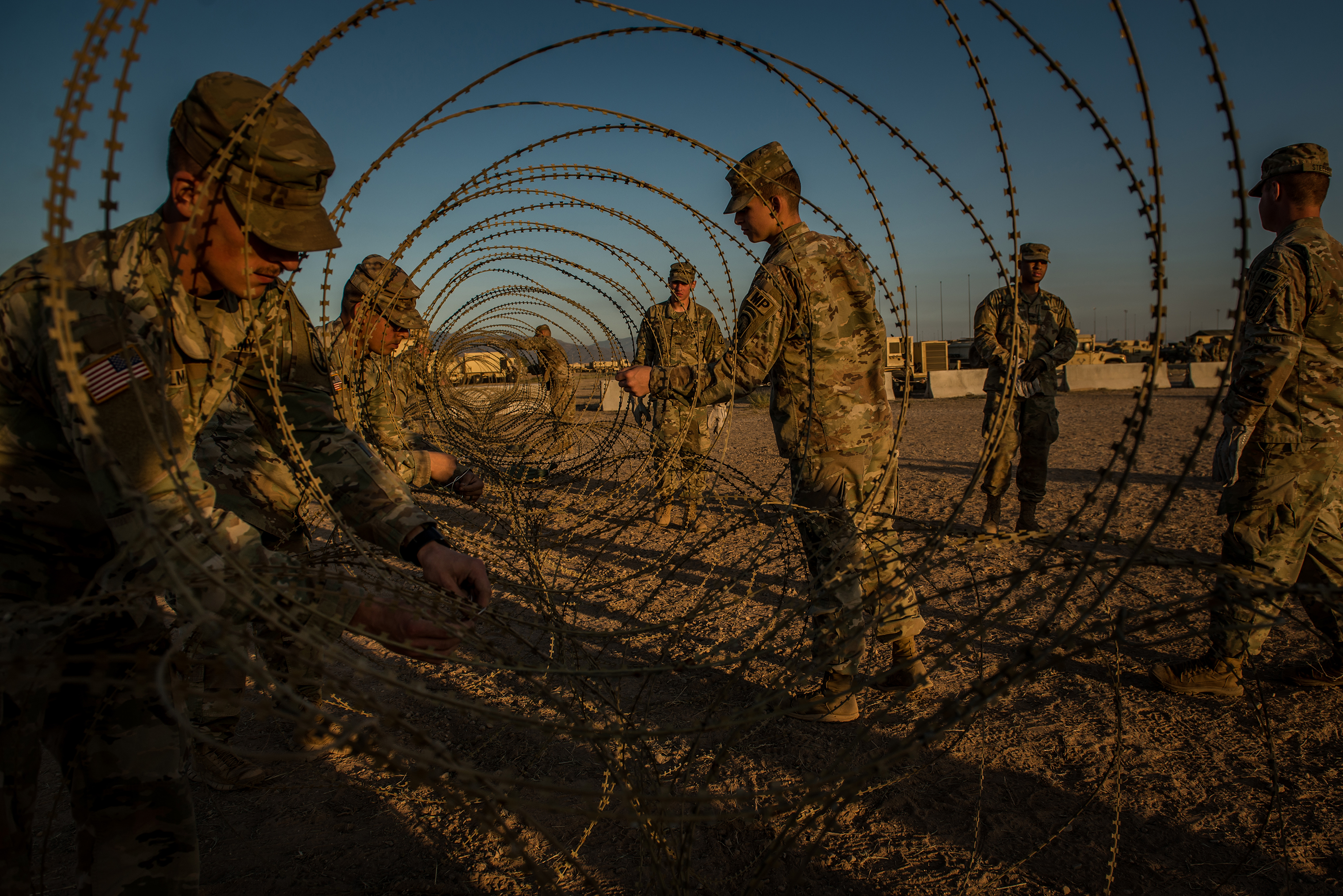 Razor wire is used to help protect a shipping container holding guns and sensitive material.