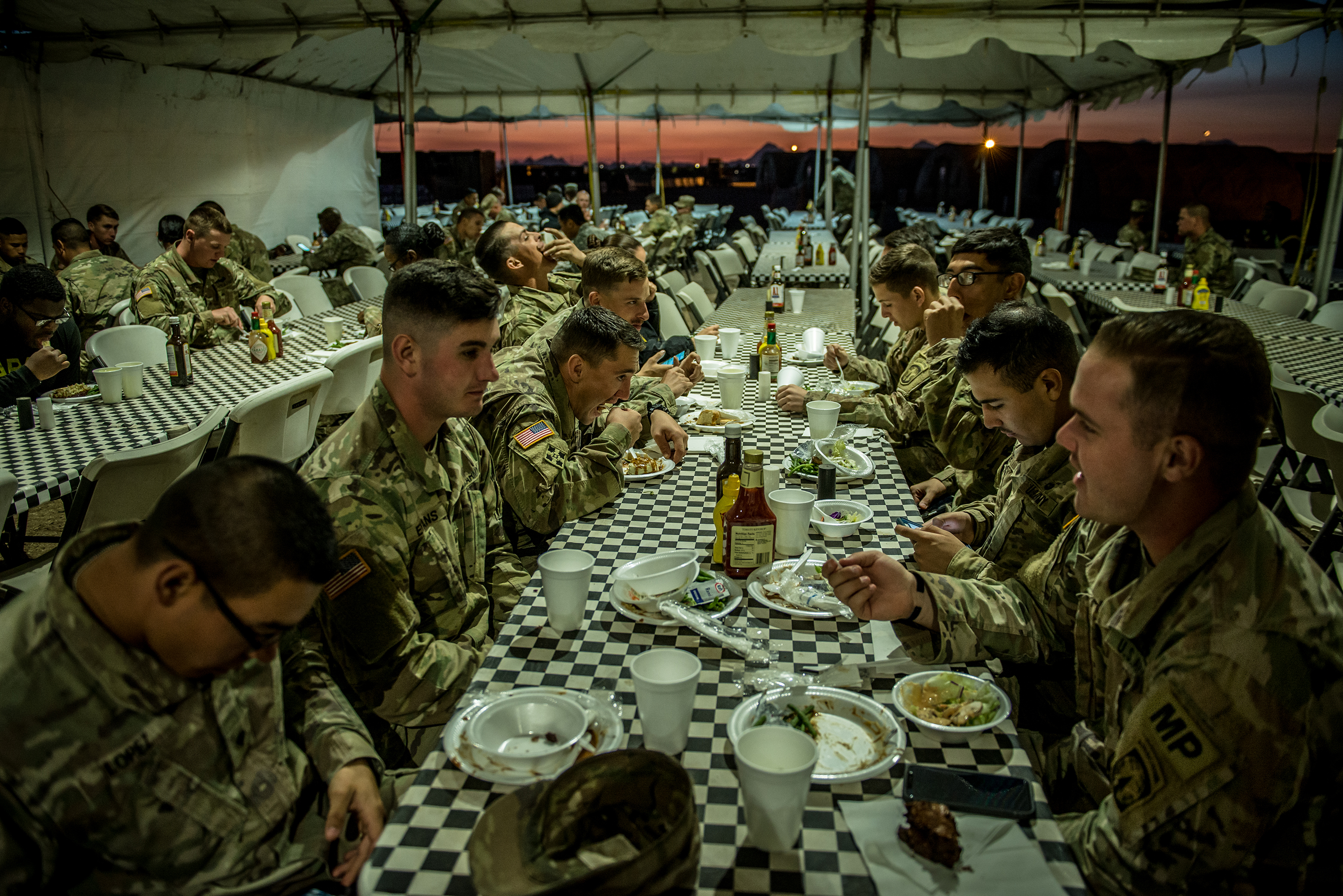 Soldiers eat dinner in the chow tent, where a Thanksgiving meal would be served, in Sunglow City, an outpost constructed in Tucson, Ariz.