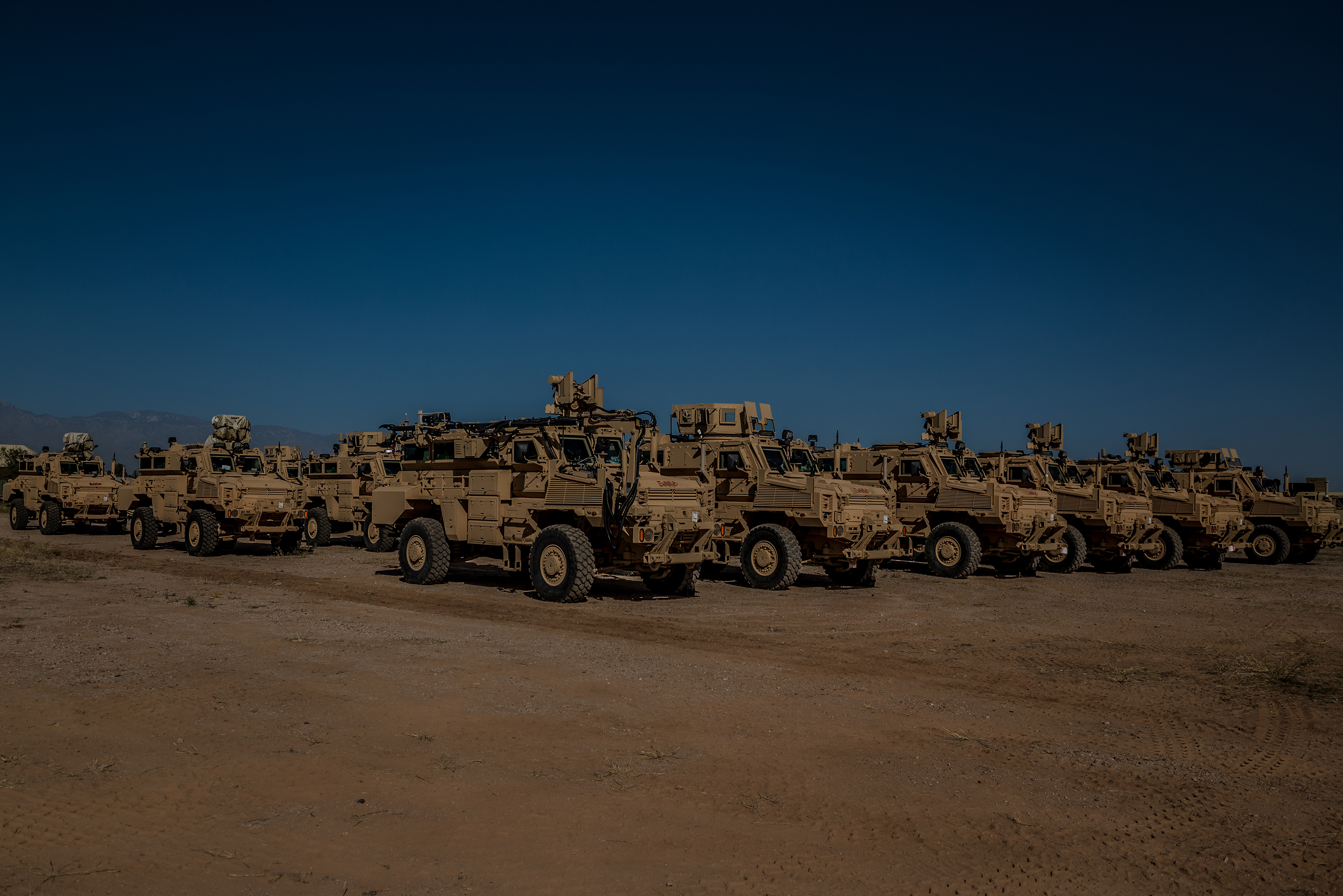More than 100 units of heavy equipment, including armored Mine-Resistant Ambush Protected vehicles, sit parked, mostly collecting dust under the desert sun. There's little chance they will be used here.