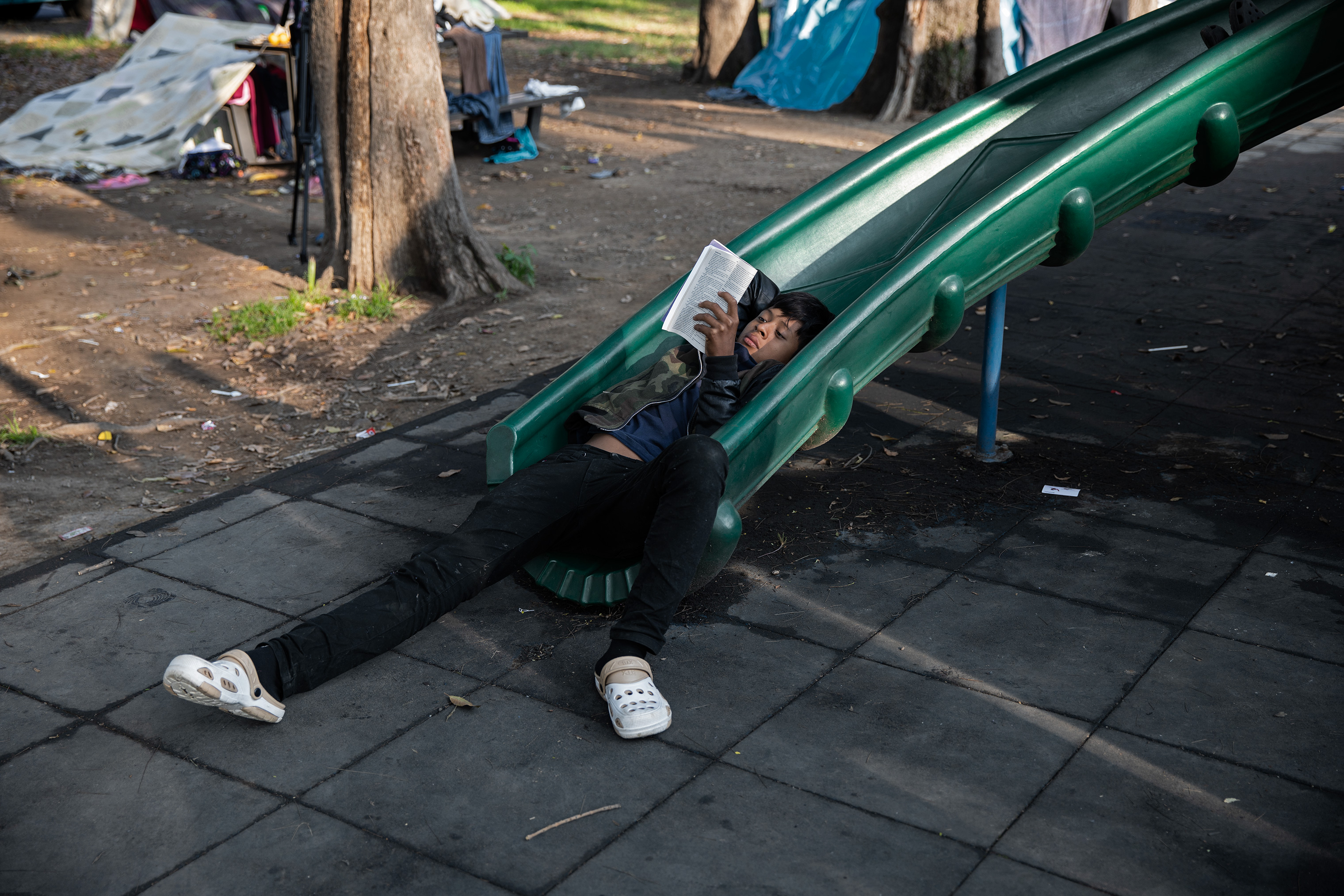 The Jesus Martinez stadium in Mexico City includes several playgrounds where some of the 2,300 minors from the caravan played, rested and read books, Nov. 7, 2018.