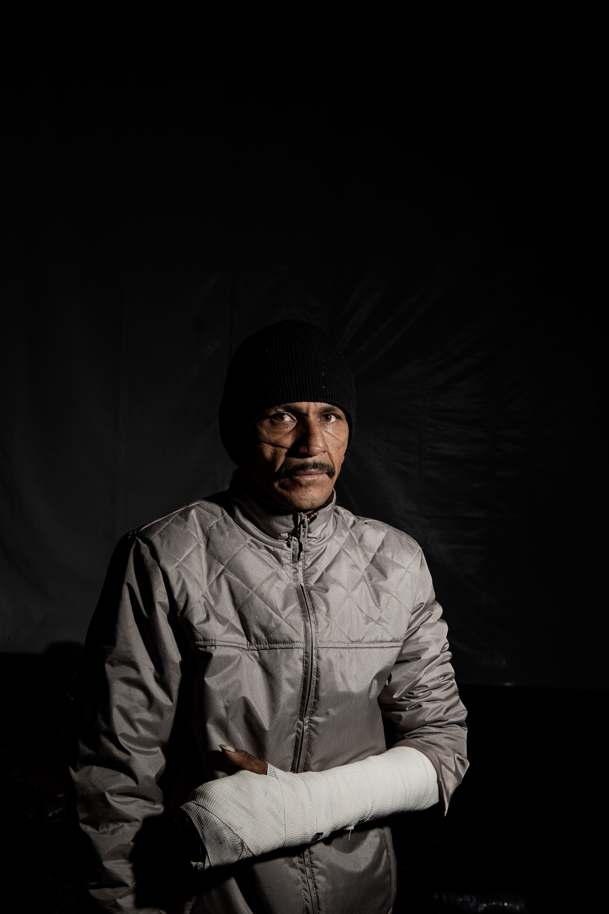 Roberto Vaughan Ordáz, 42, at the Jesus Martinez stadium on Nov. 9, 2018. Ordáz says he first tried to migrate to the US in 2015. When he arrived in Chiapas, he was kidnapped by a gang, shot eight times, cut up with a machete and left for dead. The violence remains in the scars on his face. He decided to travel with the migrant caravan for safety.