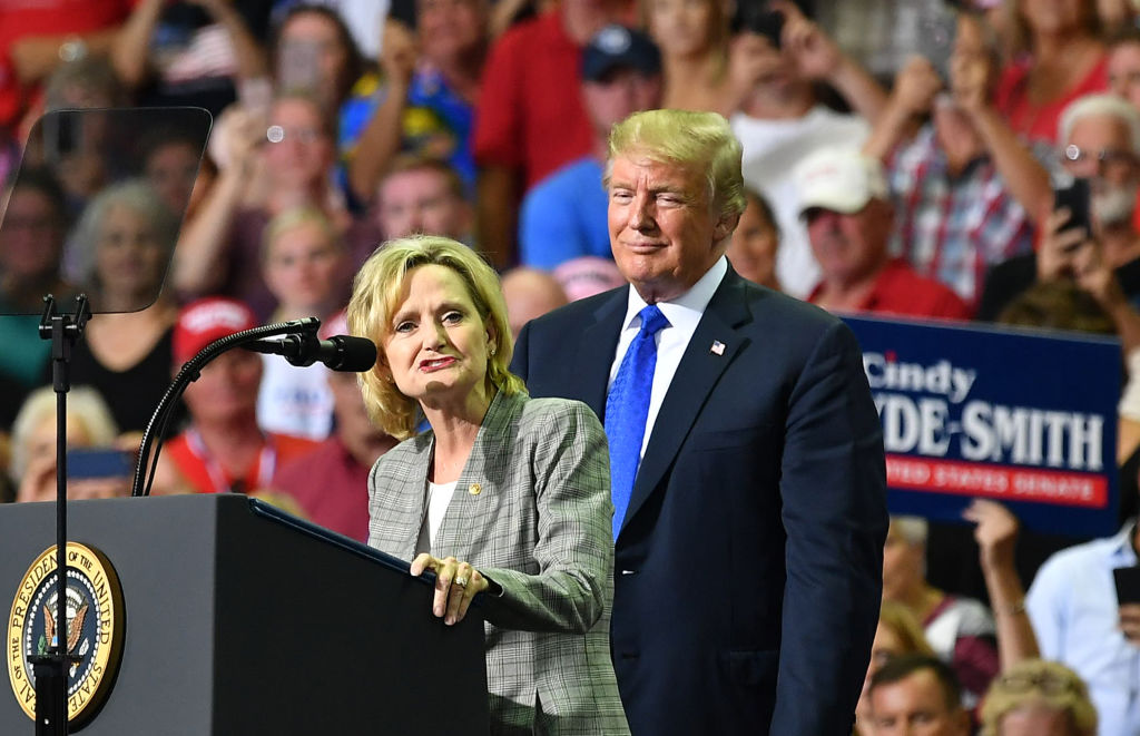 Senator Cindy Hyde-Smith stands on stage with US President Donald Trump at a  Make America Great Again  rally in Southaven, Mississippi, on October 2, 2018.
